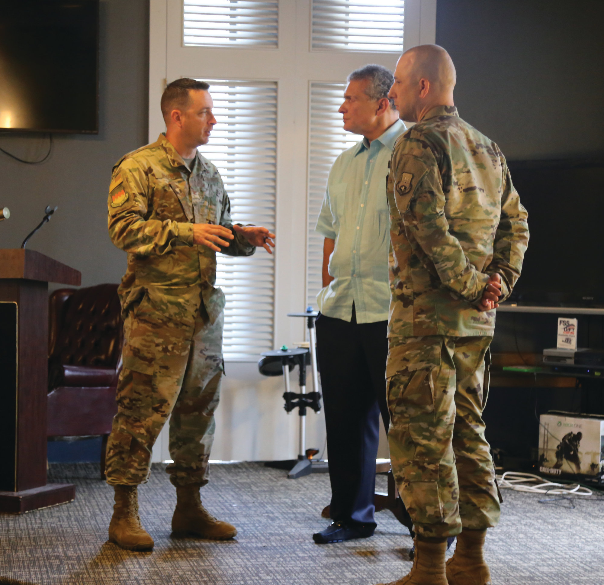 University of South Carolina head basketball coach Frank Martin, center, shares a moment with Senior Master Sgt. Christopher Harvey, right, and Col. Ryan Inman, left, following his speech on leadership at Shaw Air Force Base on Wednesday.