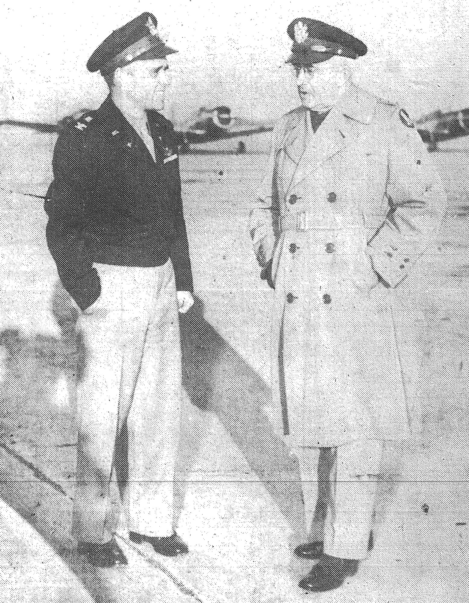 1944 - Lt. Gen. Barton K. Yount, right, commanding general of the AAF Training Command, is greeted by Col. D. W. Titus, Shaw Field's commanding officer, as the general arrived Dec. 15 for a brief, informal visit to the basic flying school and Sumter.