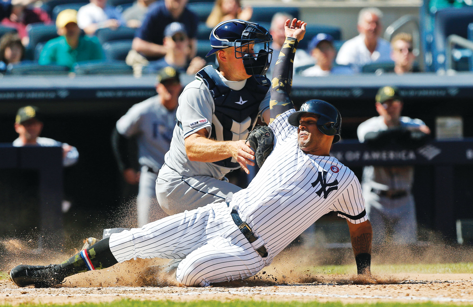 New York's Aaron Hicks, right, is tagged out at the plate by Tampa Bay Rays catcher Erik Kratz ending the sixth inning of their game Saturday in New York. Hicks tried to score from second base on a base hit by Gleyber Torres. The Rays won 2-1.