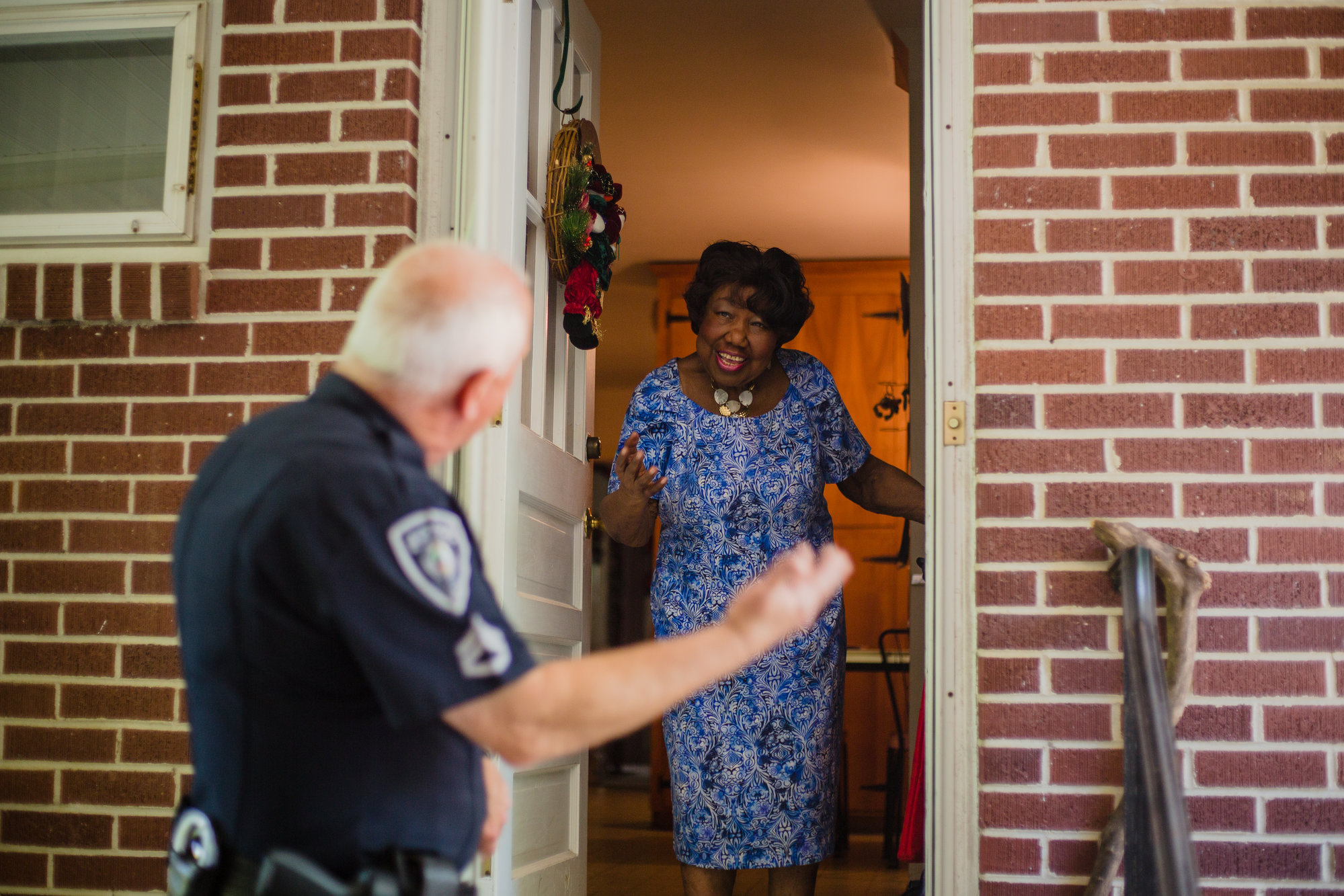 Senior Cpl. Warren Davis with Project Checkmate, a program created through Sumter Police Department, meets Mildred Byrden at her home Wednesday in Sumter. Davis checks up on 43 seniors living alone across Sumter each week, often also helping with tasks such as changing lightbulbs and driving them to doctor appointments.