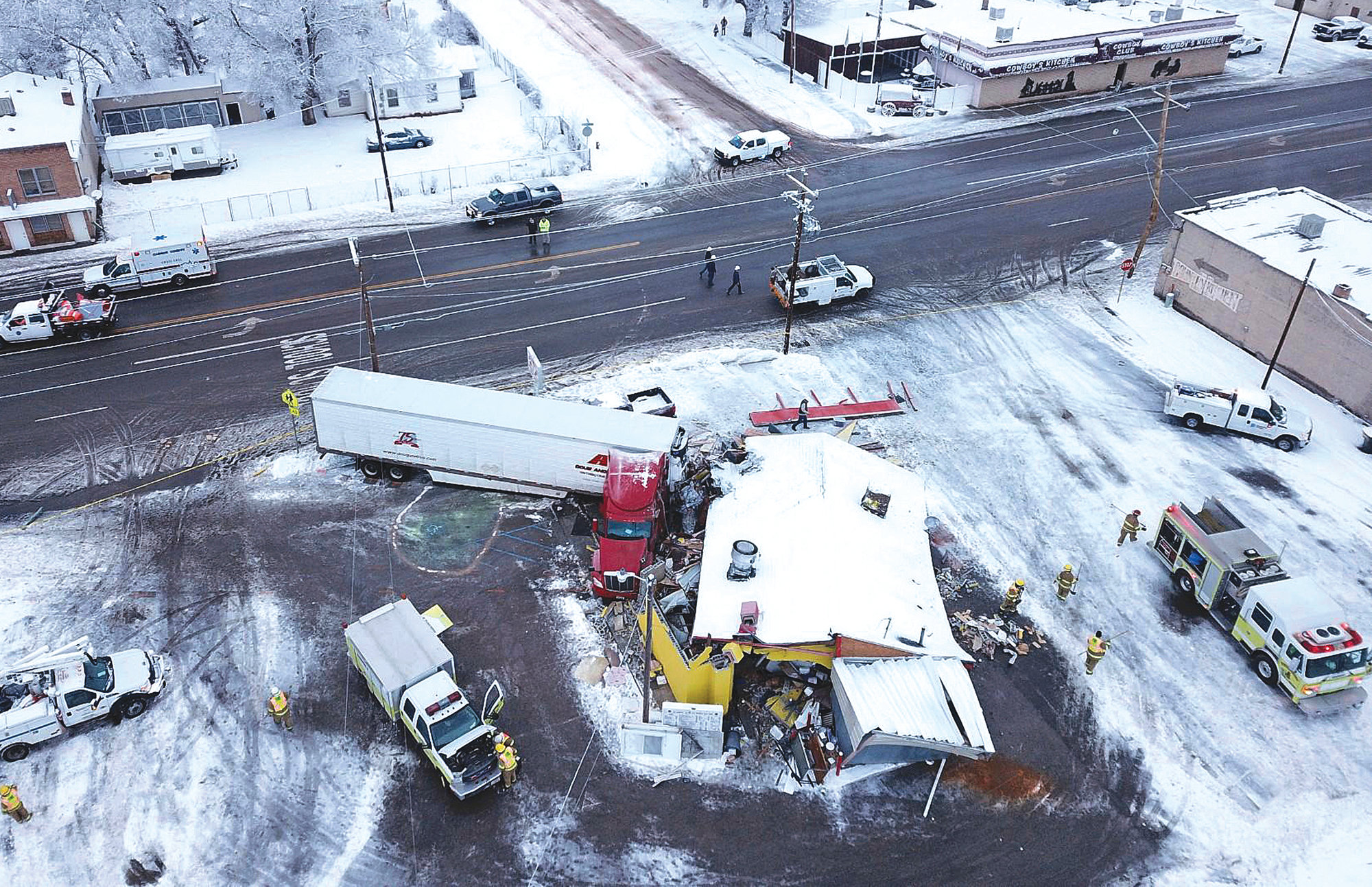 This photo taken by a Utah Highway Patrol drone shows a big rig that crashed into a restaurant in Wellington, Utah. A survey released Monday shows transportation agencies are using drones in nearly every U.S. state.
