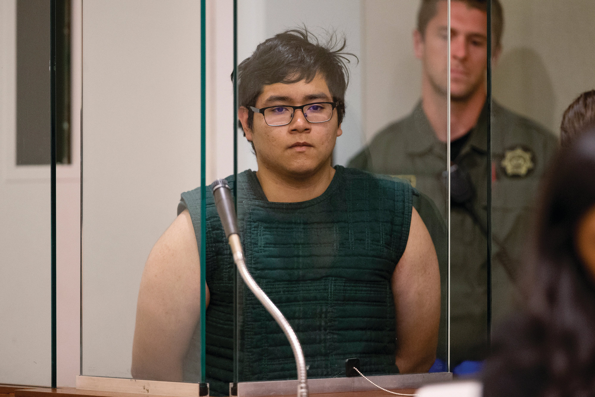 Angel Granados-Diaz, 19, a Parkrose High School student accused of bringing a shotgun to class on Friday, appears in a brief court hearing in Portland, Oregon, on Monday. Granados-Diaz pleaded not guilty during the brief court hearing to a felony count of possessing a weapon in a public building and three misdemeanors.