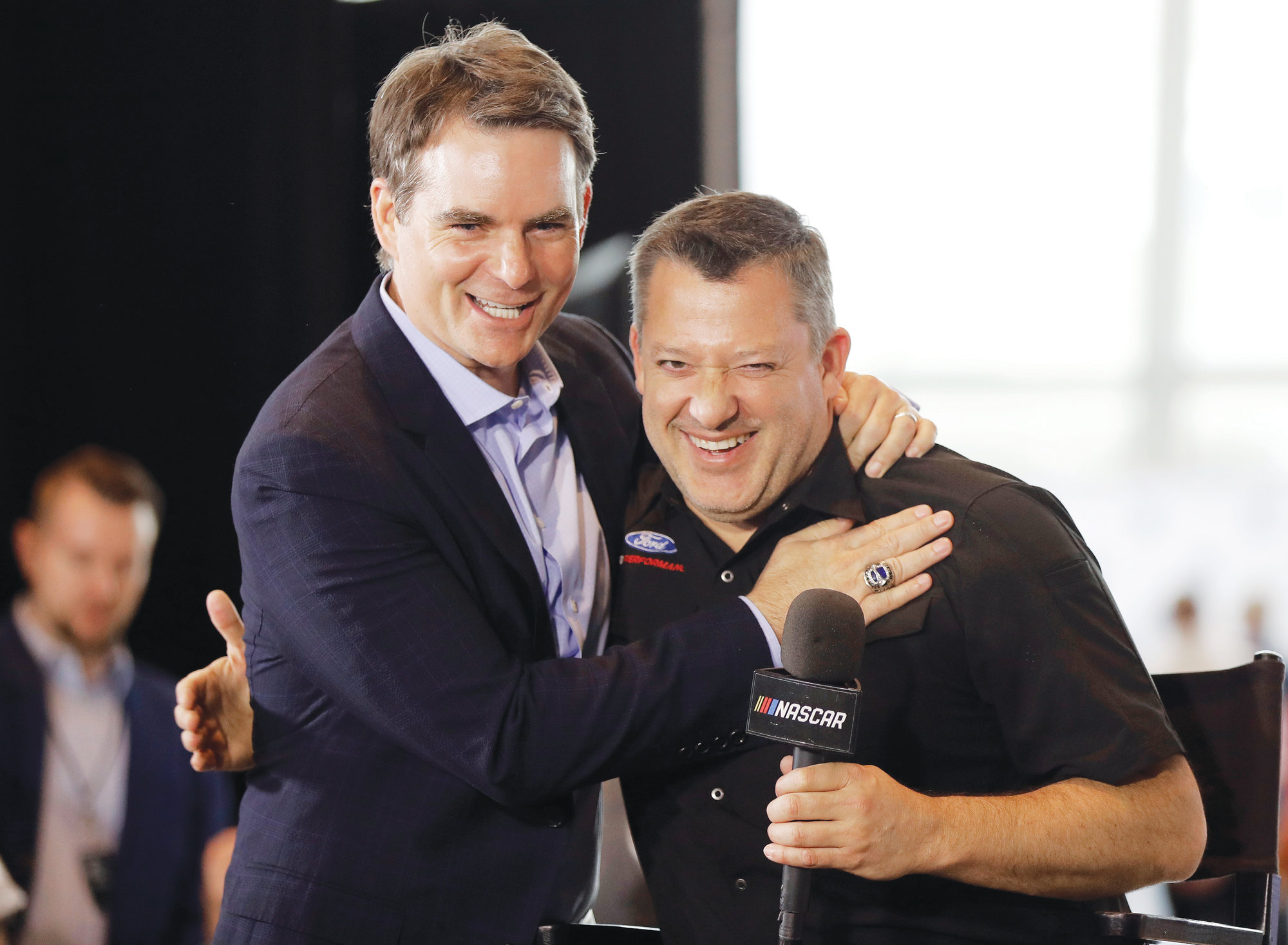 Tony Stewart, right, is congratulated by Jeff Gordon after being named to the NASCAR Hall of Fame class of 2020 during an announcement in Charlotte on Wednesday.