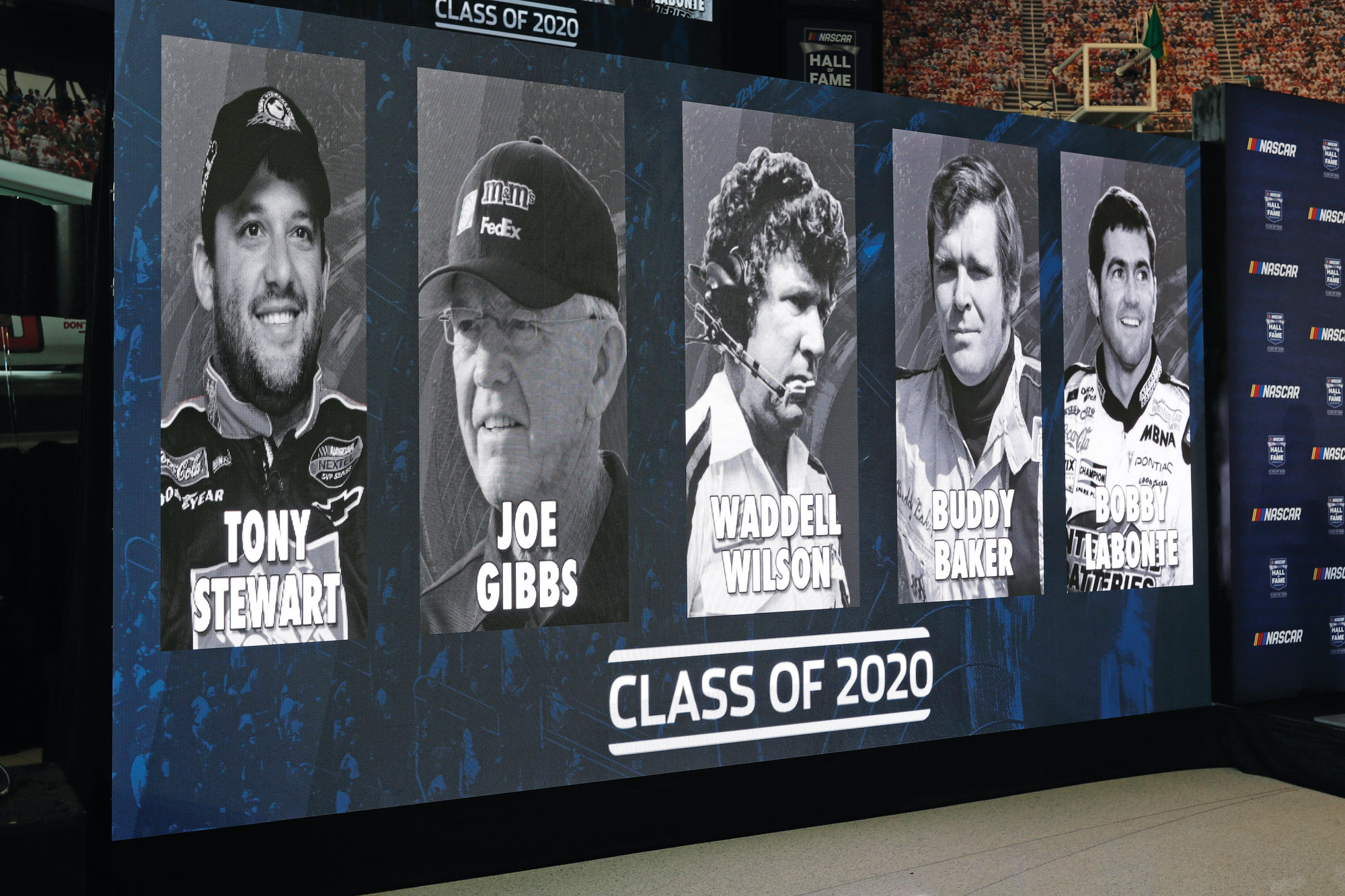 Images of Tony Stewart, Joe Gibbs, Waddell Wilson, Buddy Baker and Bobby Labonte, left to right, are shown during the announcement of them being the 2020 NASCAR Hall of Fame class on Wednesday in Charlotte.