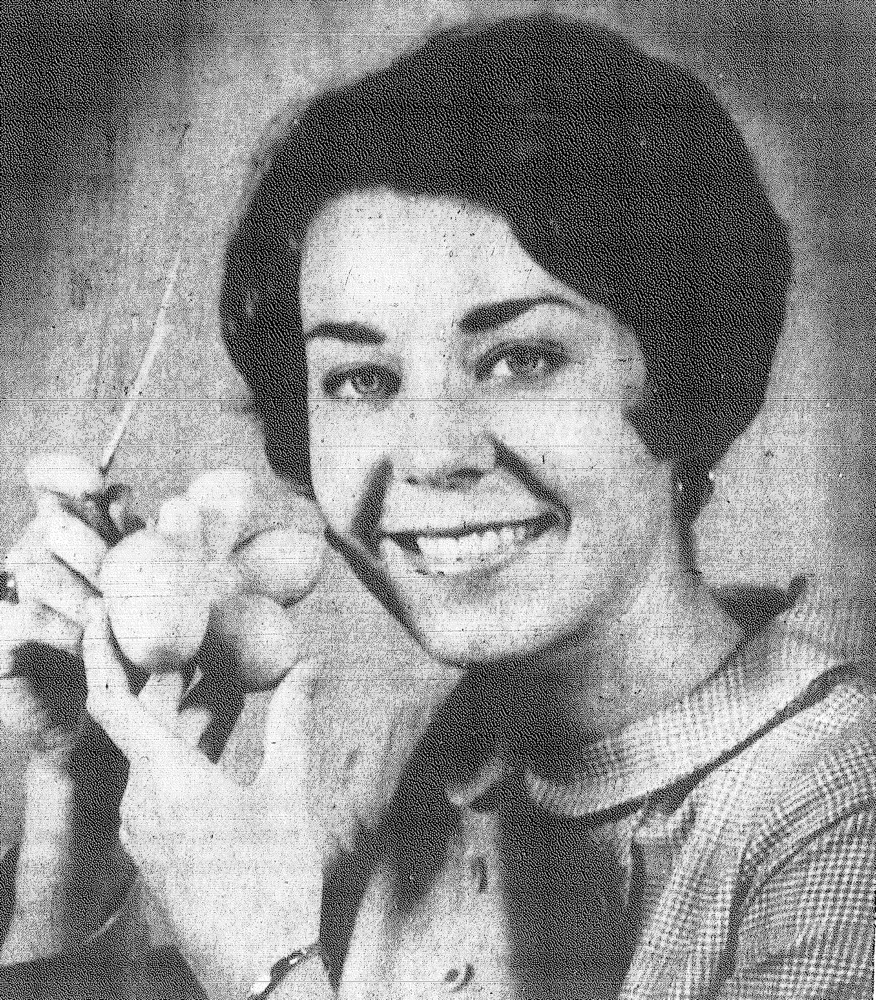 1969 - Mary Wayne Adams, Item summer employee, displays a bizarre tomato found growing behind the Item building. The tomato ripened and was given to her father, Item production superintendent J.C. Adams, who didn't know whether to eat it or patent it.