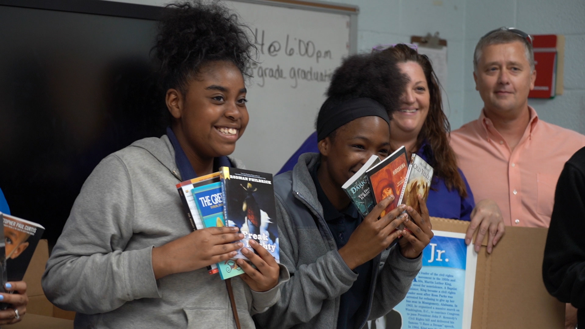 Ebenezer Middle School students show some of the books bought for their classroom by Sumter manufacturer BD. The company has adopted their school and will provide support for teachers and students.