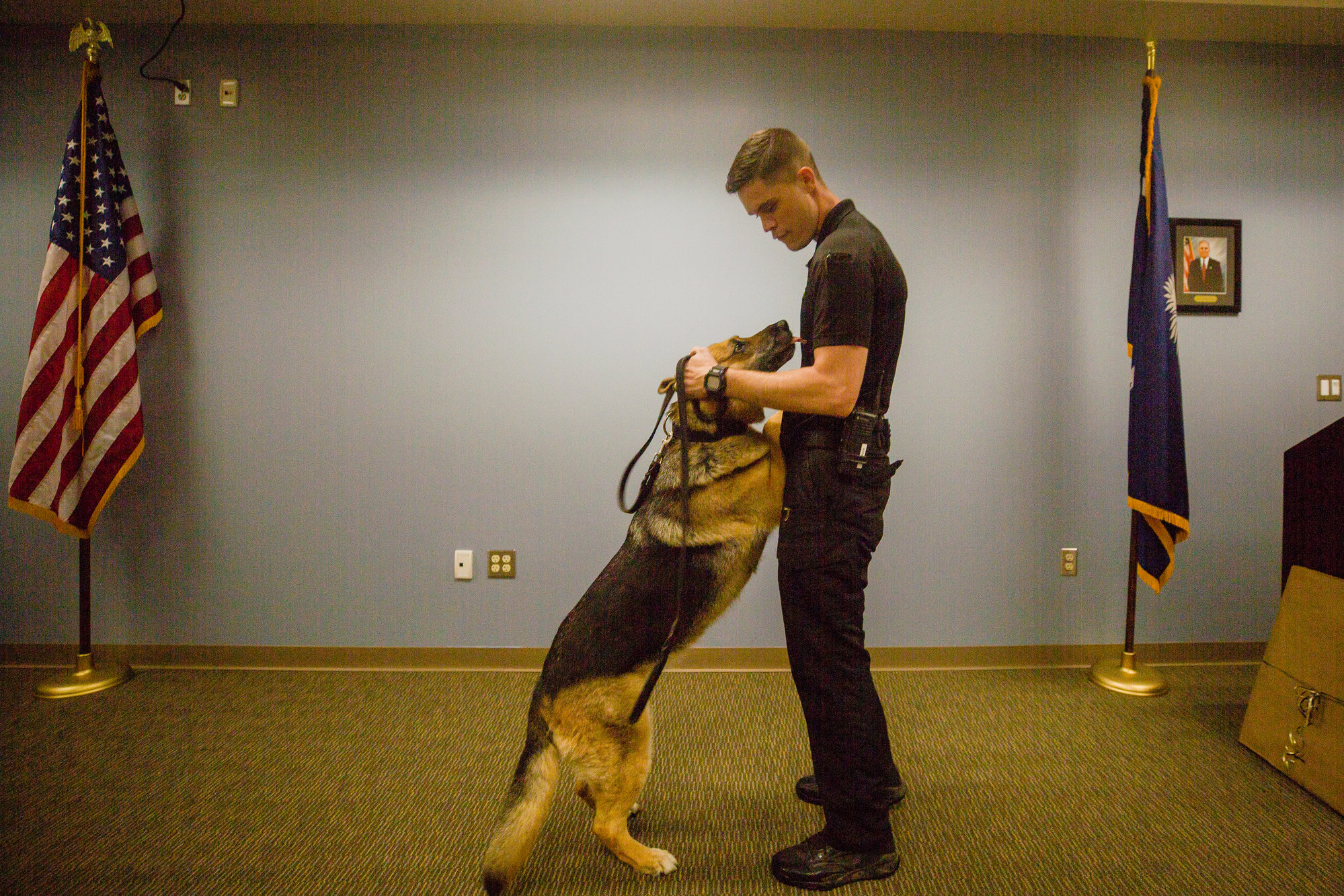 K-9 Dina, who officially retired from the Sumter County Sheriff's Office on Friday, is seen with her handler, Cpl. Evan Rogerson. She will now be a pet at Rogerson's home after nine years of service.