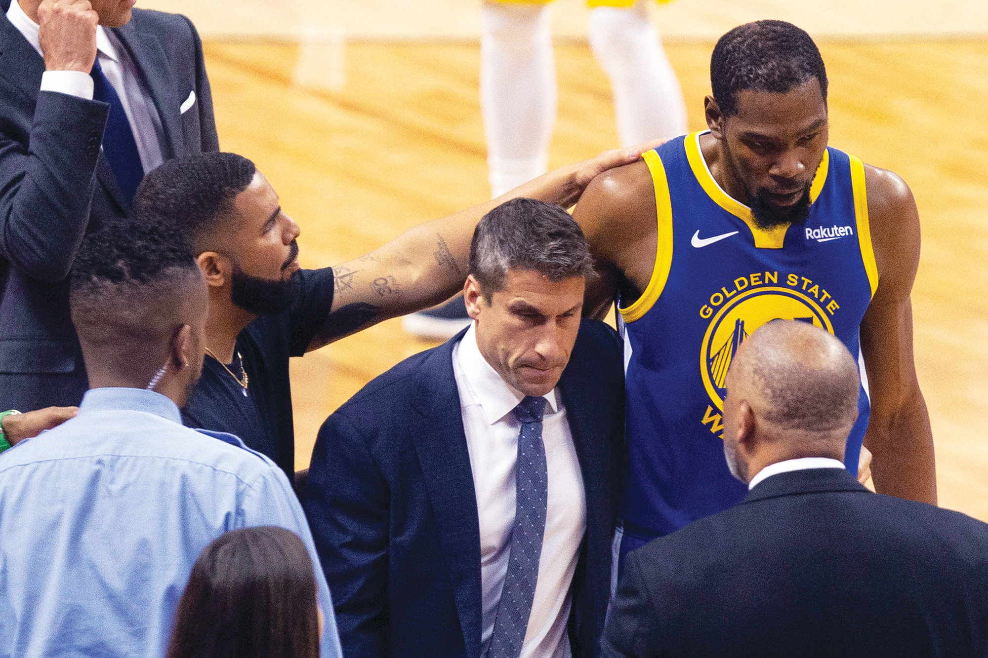 Chris Young / The Canadian Press via AP  Golden State forward Kevin Durant, right, is consoled by Drake as Durant walks off the court after sustaining an injury during Game 5 of the NBA Finals against Toronto on Monday in Toronto.