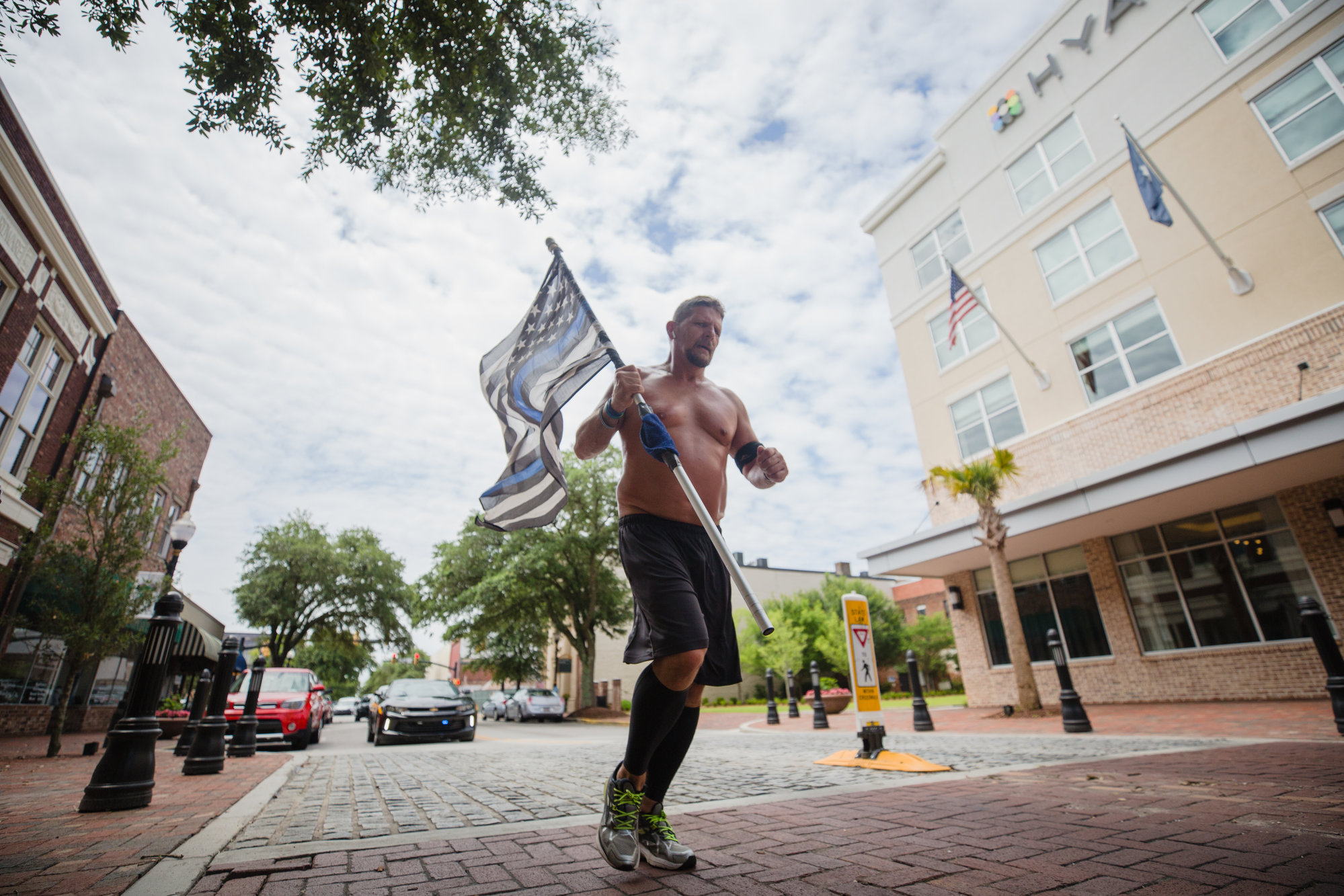 Daniel Watson runs down Main Street in Sumter on Tuesday afternoon.