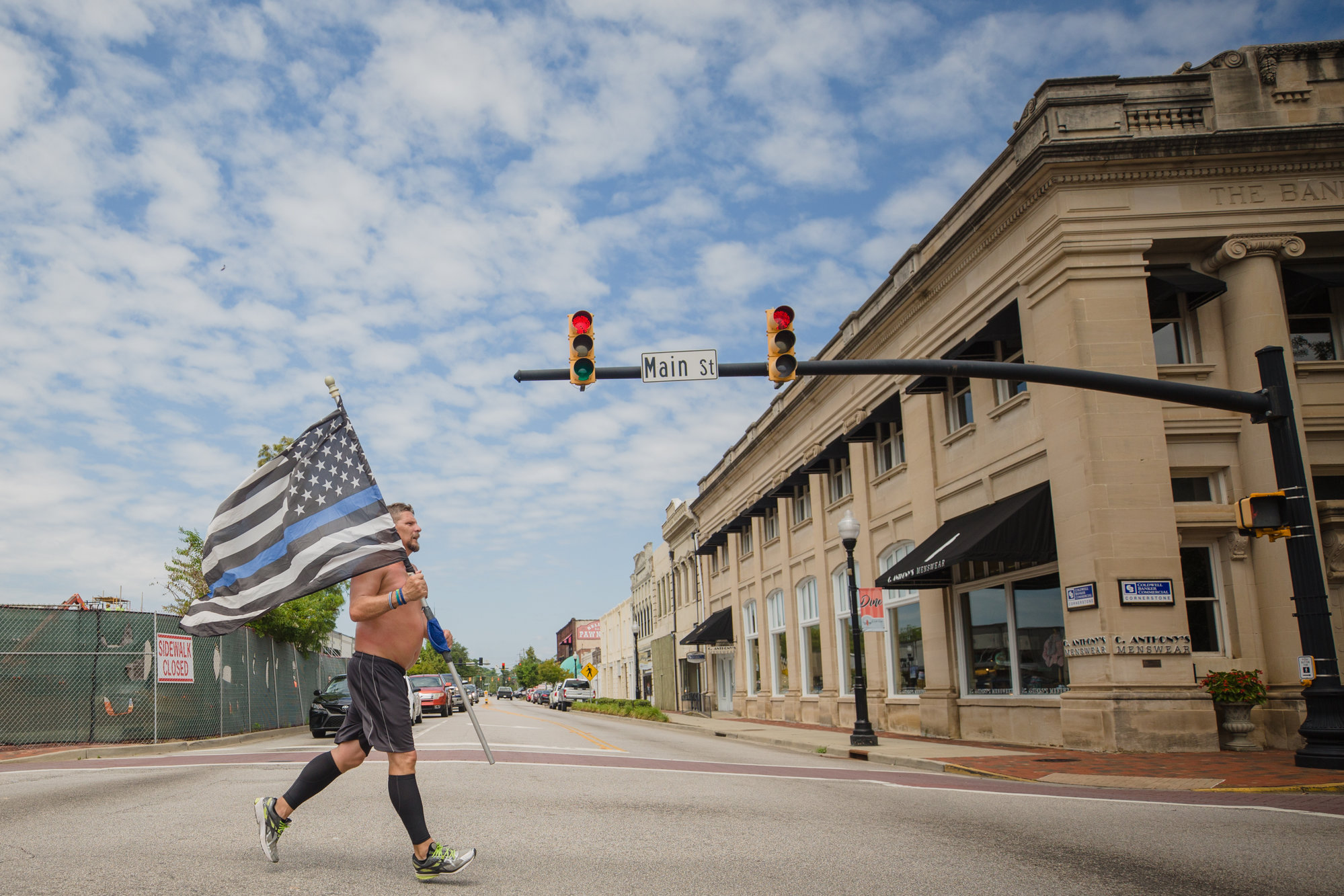 Daniel Watson runs down Main Street in Sumter on Tuesday afternoon. He was completing his half-marathon section of a relay run to honor the 384 fallen officers in South Carolina.