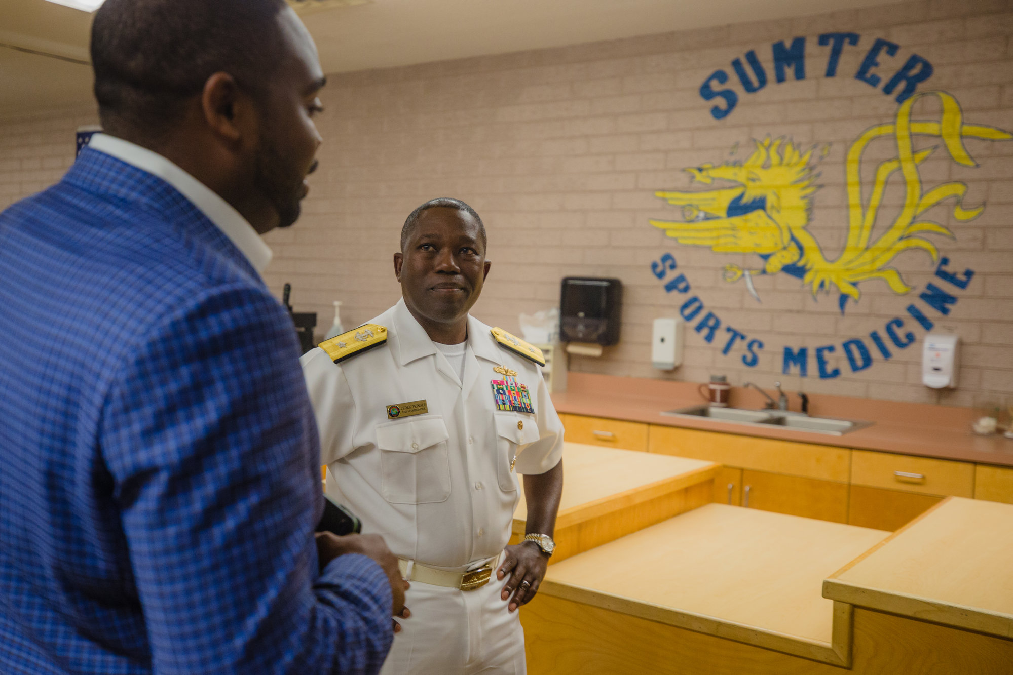 Rear Adm. Cedric Pringle talks with SHS Principal Nicholas Pearson on Monday during his visit to Sumter.