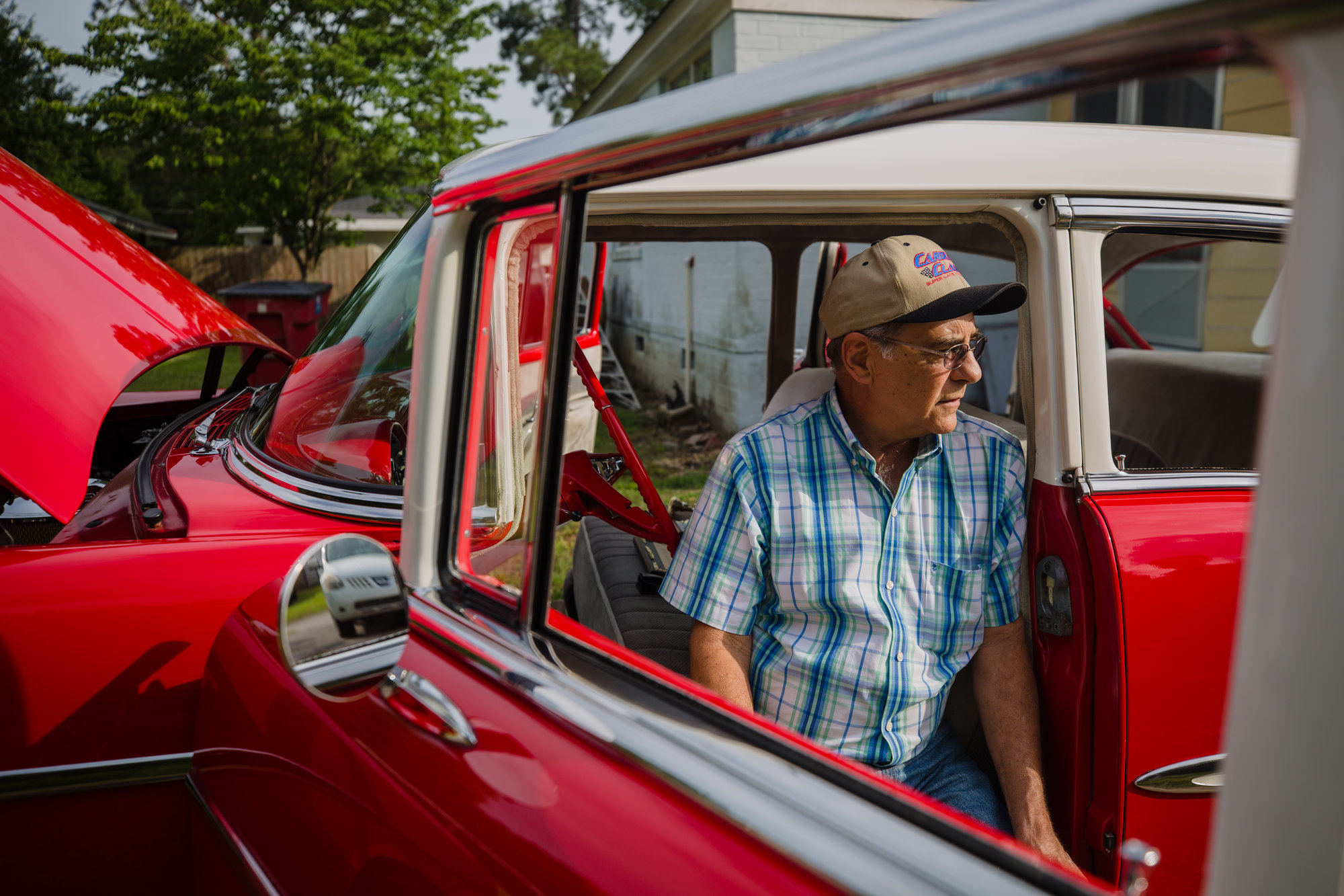 Harold Hodge sits in the front seat of his '55 Chevrolet Bel Air, which he bought in 1965. He worked as a mechanic for decades and restored the family car, which he now brings to car shows. His son, Glenn, is a fourth-generation mechanic.
