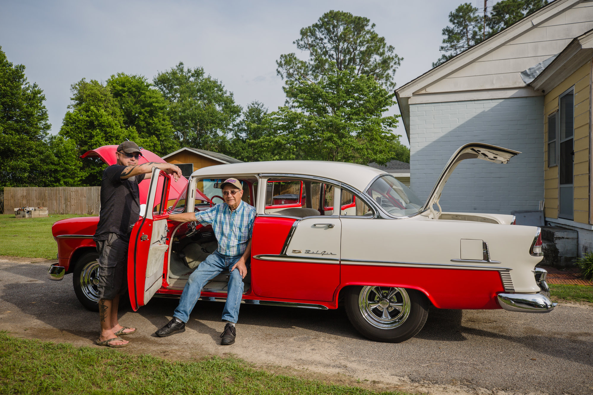 Harold Hodge and his son, Glenn, are seen with Harold's '55 Chevy Bel Air.