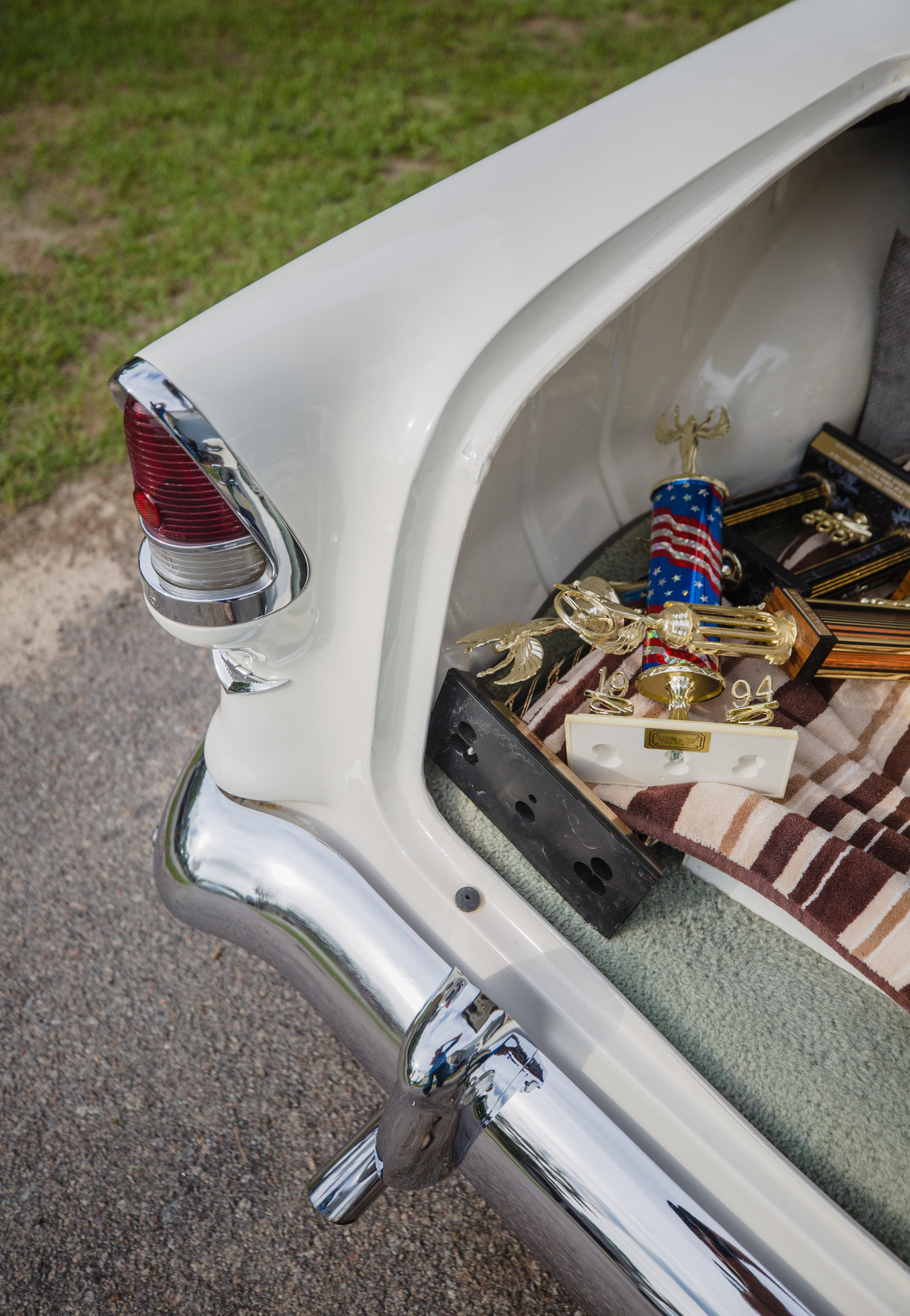 Trophies are loaded into the trunk of Harold's '55 Chevy Bel Air.