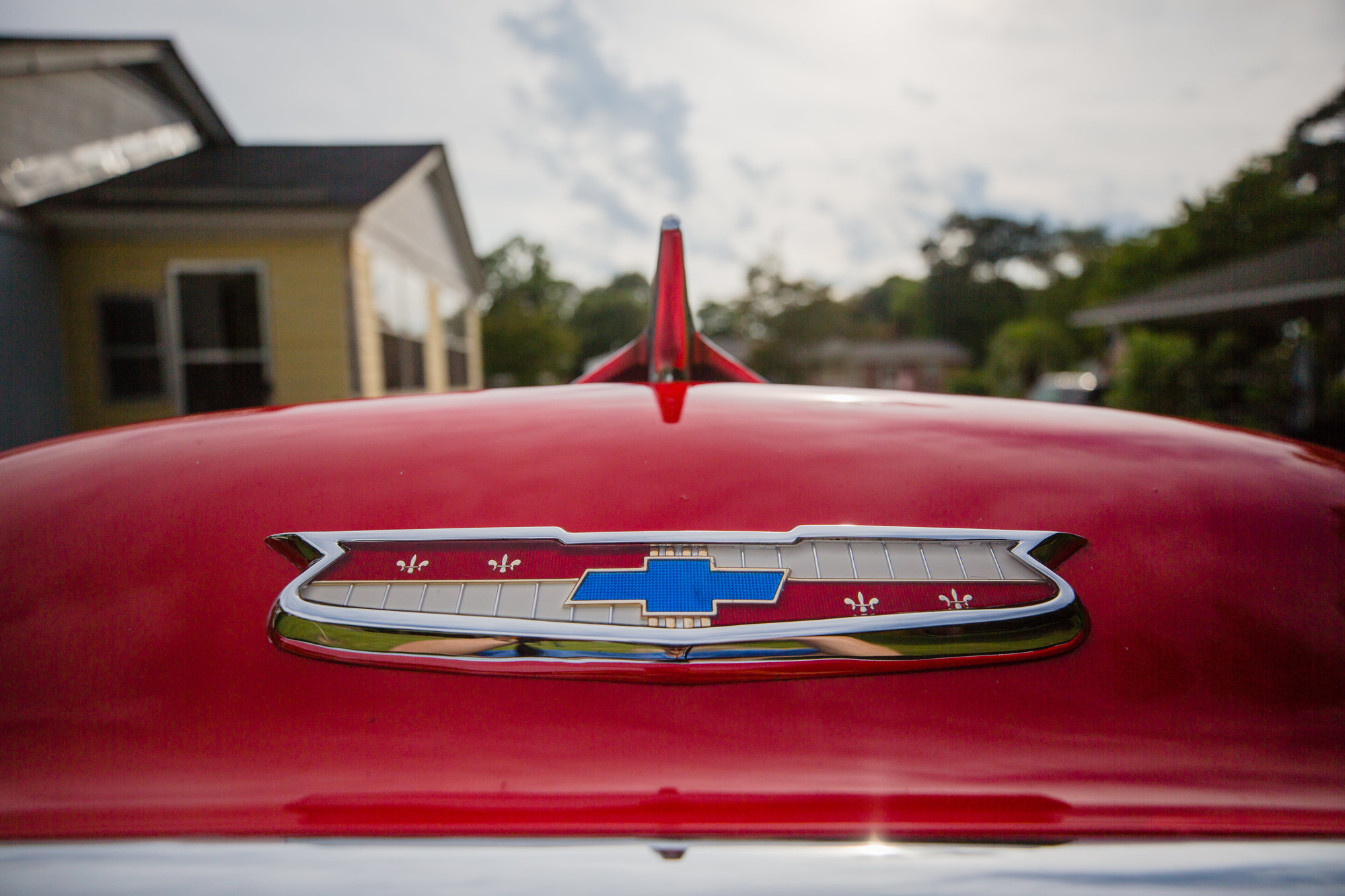 The hood ornament on Harold Hodge's '55 Chevy Bel Air is seen.