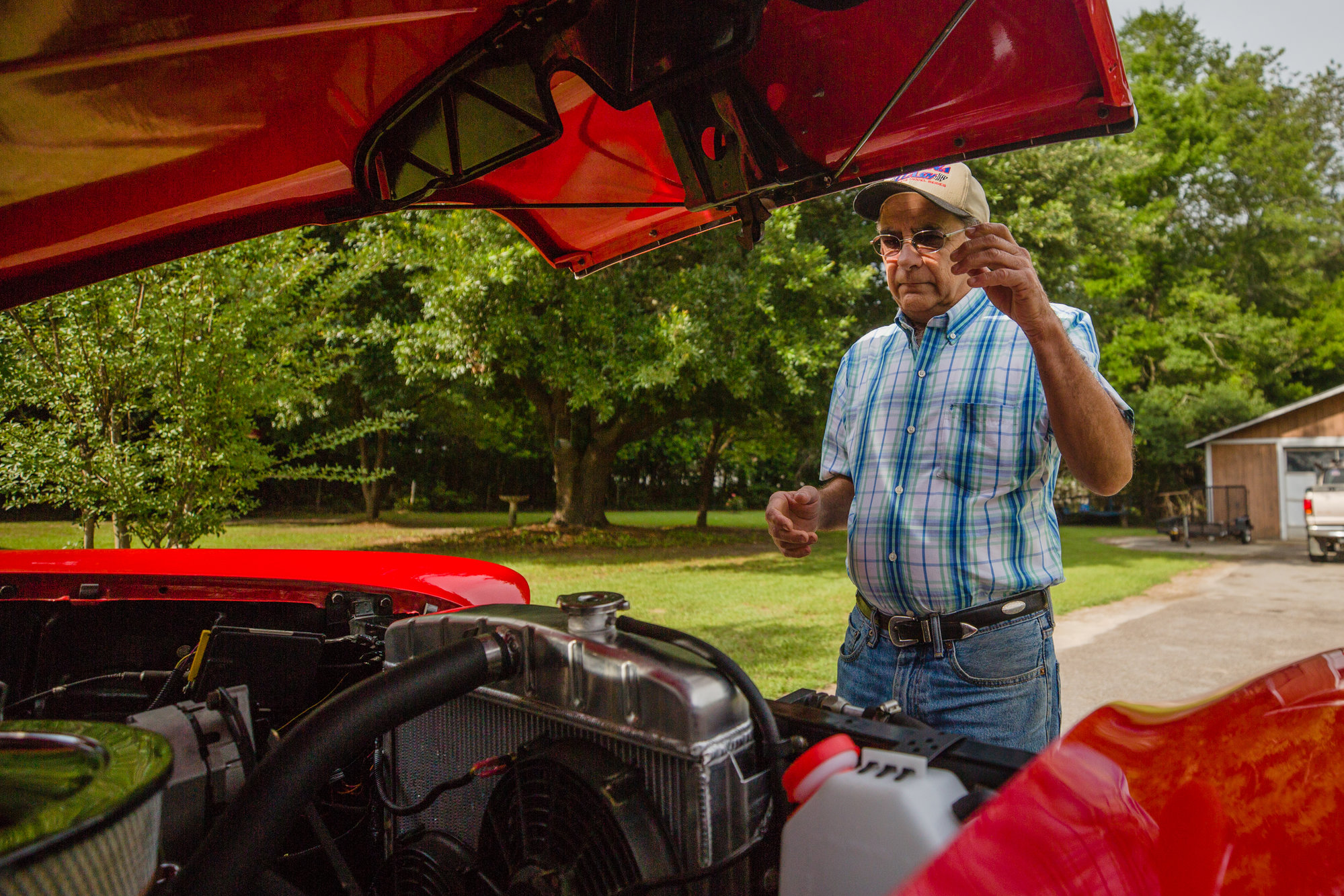 Harold Hodge pops the hood of his '55 Chevy Bel Air.