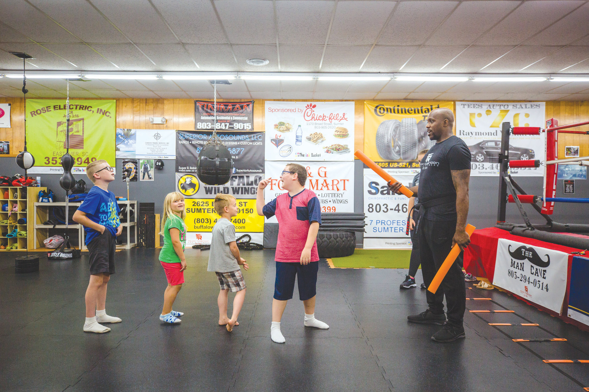 Jerome Robinson of Team Robinson MMA gives directions to students from Clubhouse Learning Center in Sumter on Monday morning. The group makes a trip to the gym every Monday during the summer, where Jerome and his team teach them basic self defense skills and work outs.