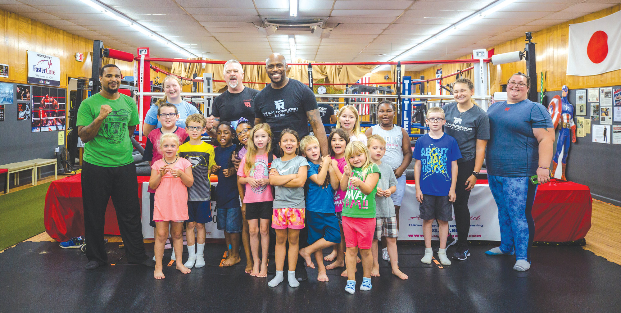 Jerome Robinson of Team Robinson MMA and students Clubhouse Learning Center on Monday morning. The group makes a trip to the gym every Monday during the summer, where Jerome and his team teach them basic self defense skills and work outs.