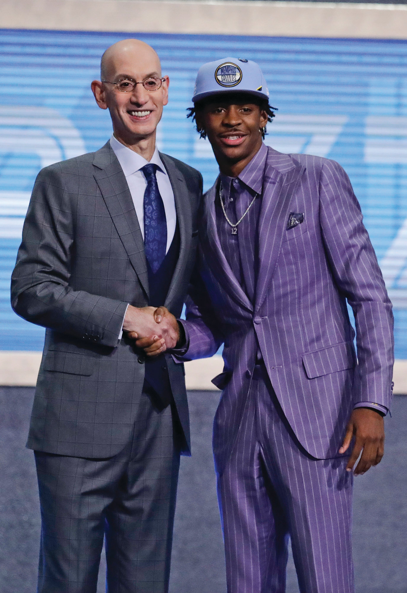 Murray State's Ja Morant, right, is  greeted by NBA Commissioner Adam  Silver after being selected by the Memphis Grizzlies with the second pick in  the NBA draft on Thursday in Brooklyn, New York.
