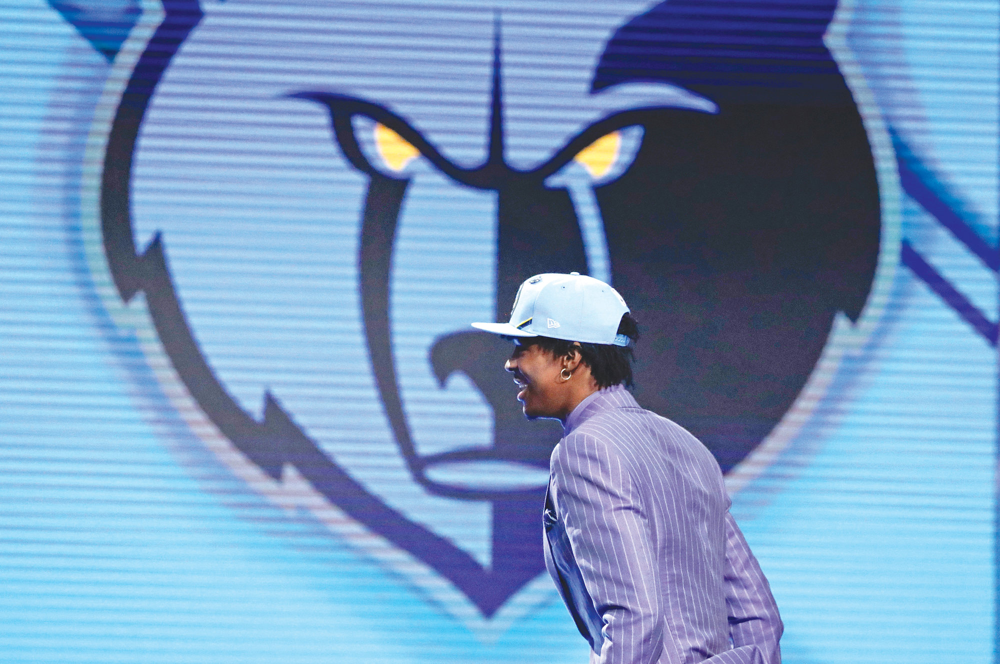 Murray State's Ja Morant walks on stage after being selected the second pick overall by the Memphis Grizzlies during the NBA basketball draft Thursday in New York.