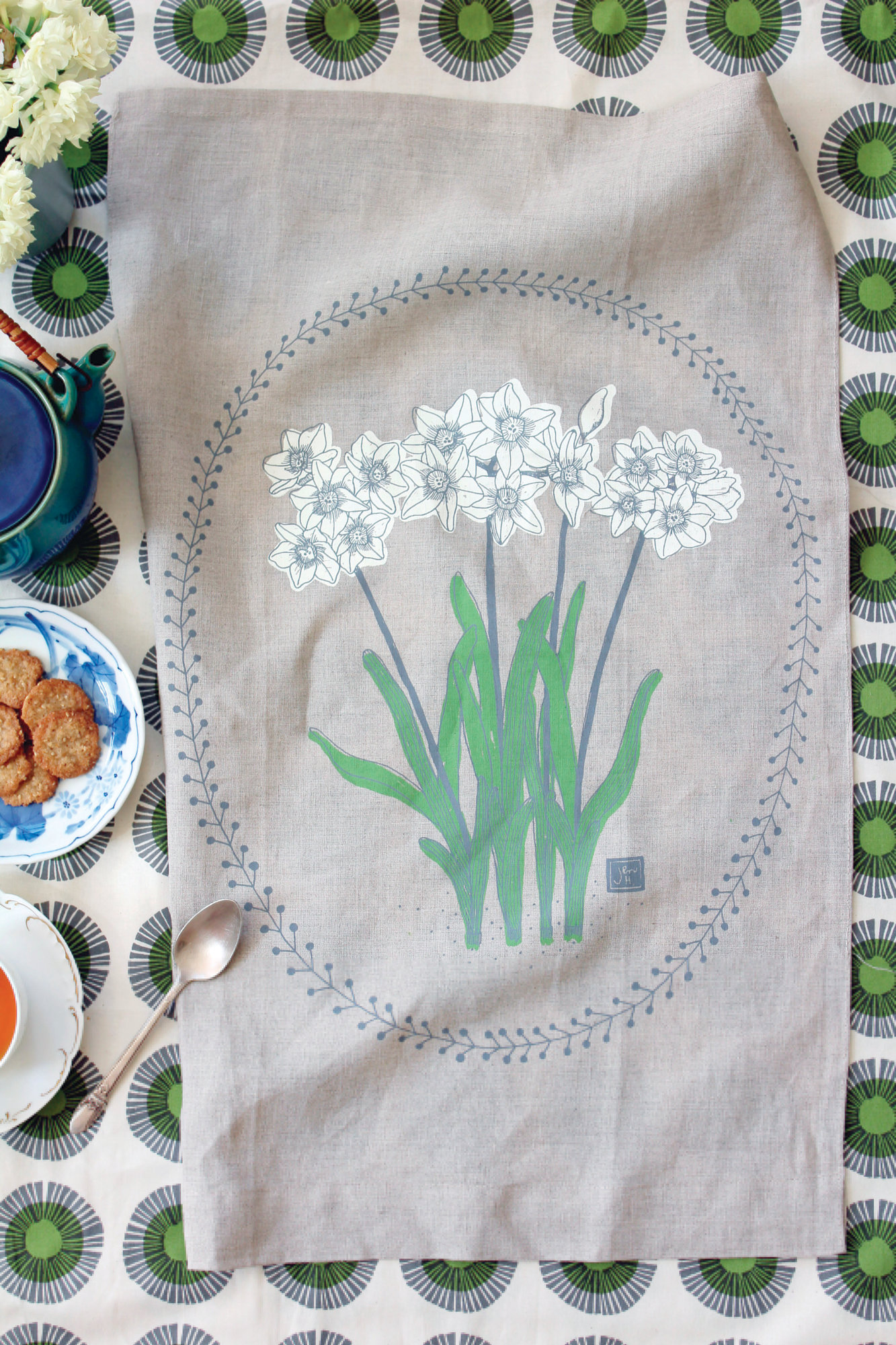 Jen Hewett via AP   Seen is a Paperwhites tea towel, three-color screenprint on linen and designed by Jen Hewett.