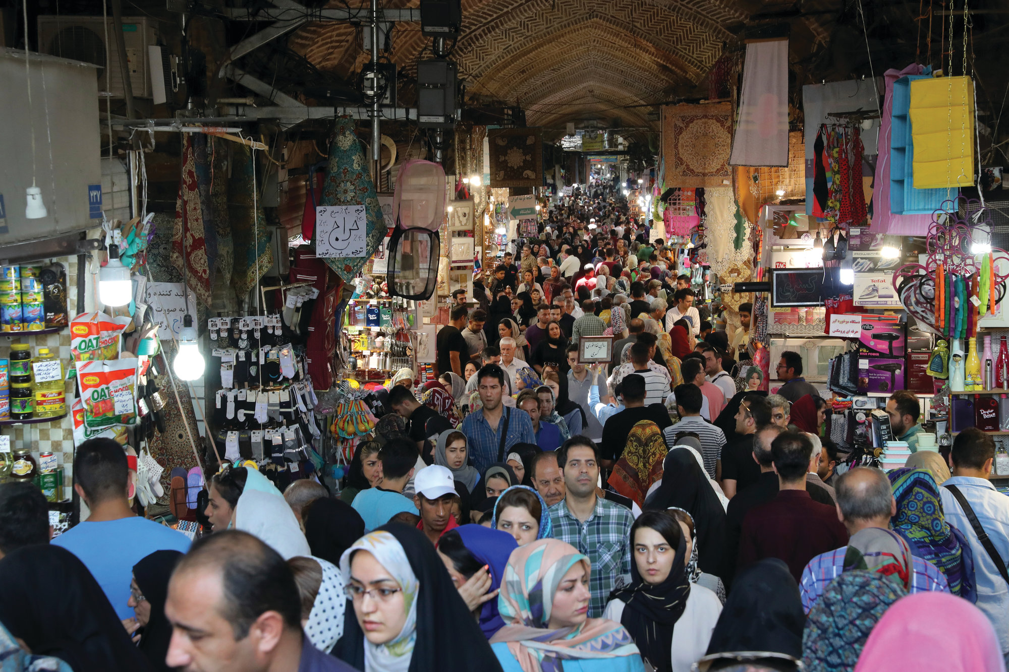 THE ASSOCIATED PRESS  People shop at the old main bazaar in Tehran, Iran, on Sunday. As the U.S. piles sanction after sanction on Iran, it's the average person who feels it the most.
