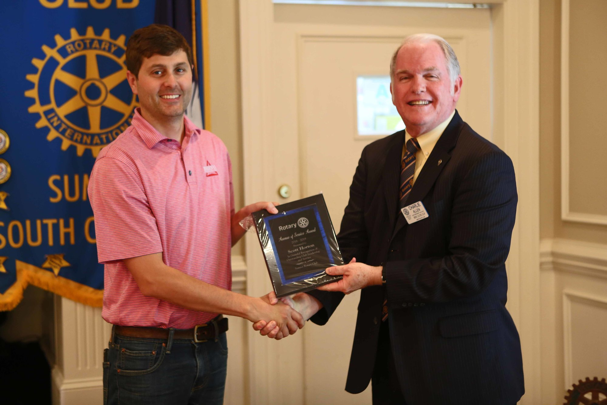 Scott Horton, left, receives the Avenue of Service Award from Sumter Rotary Club President Charlie Allen.