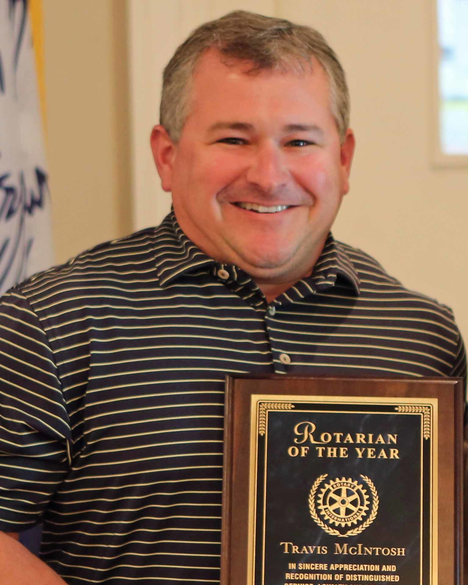 PHOTOS PROVIDEDTravis McIntosh was honored with the Rotarian of the Year award at the Sumter Rotary Club meeting on Monday.