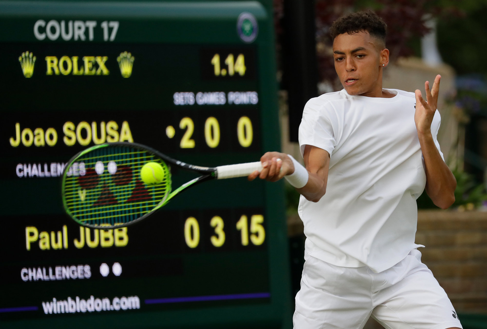 Paul Jubb, who won the NCAA singles championship playing for South Carolina, returns a shot to Joao Sousa in his straight-set loss in a first-round match of Wimbledon on Tuesday.
