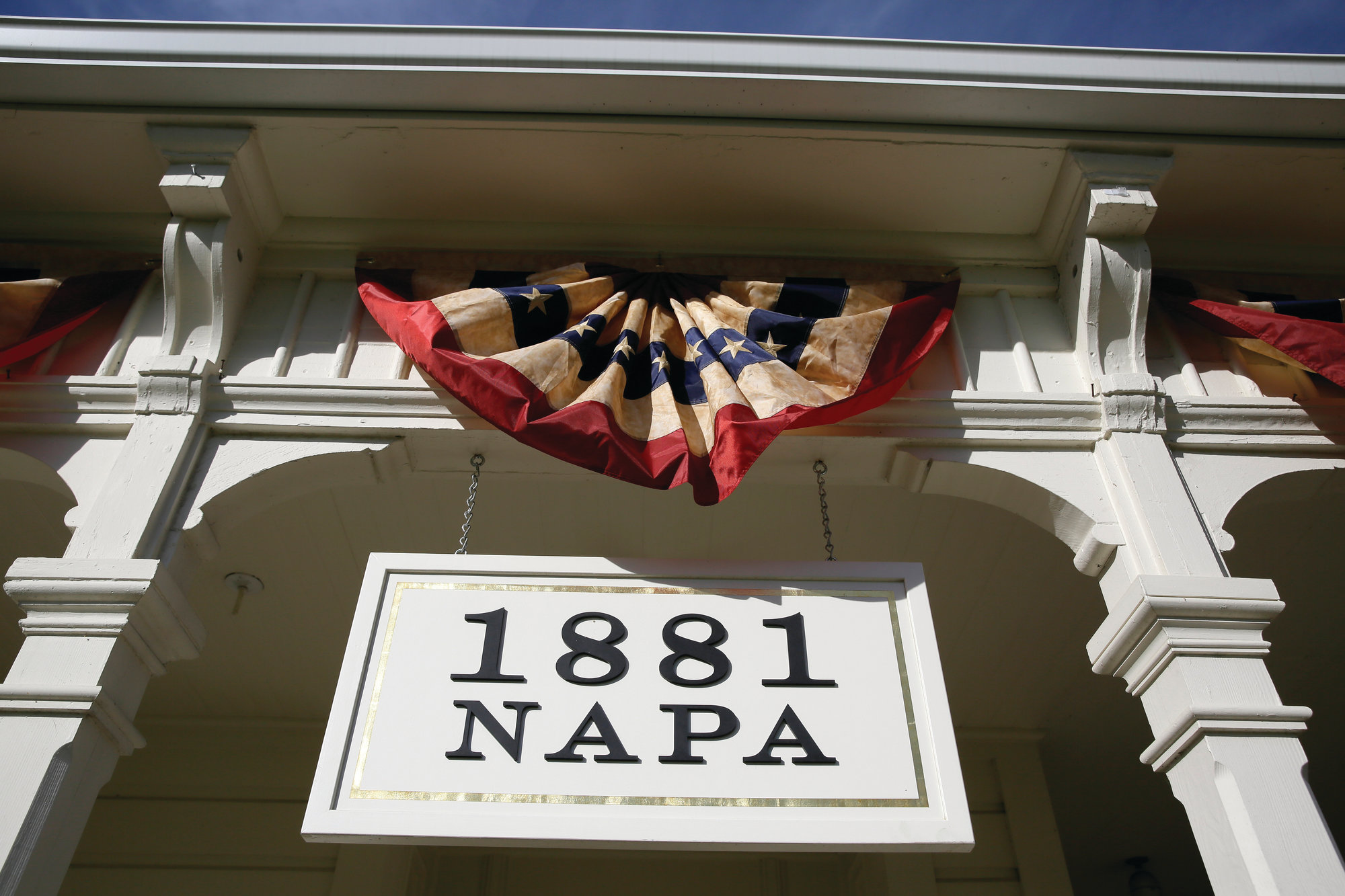 The Associated Press In this photo taken Wednesday, June 5, 2019, a sign and bunting hangs over the entrance to 1881 Napa in Oakville, Calif.