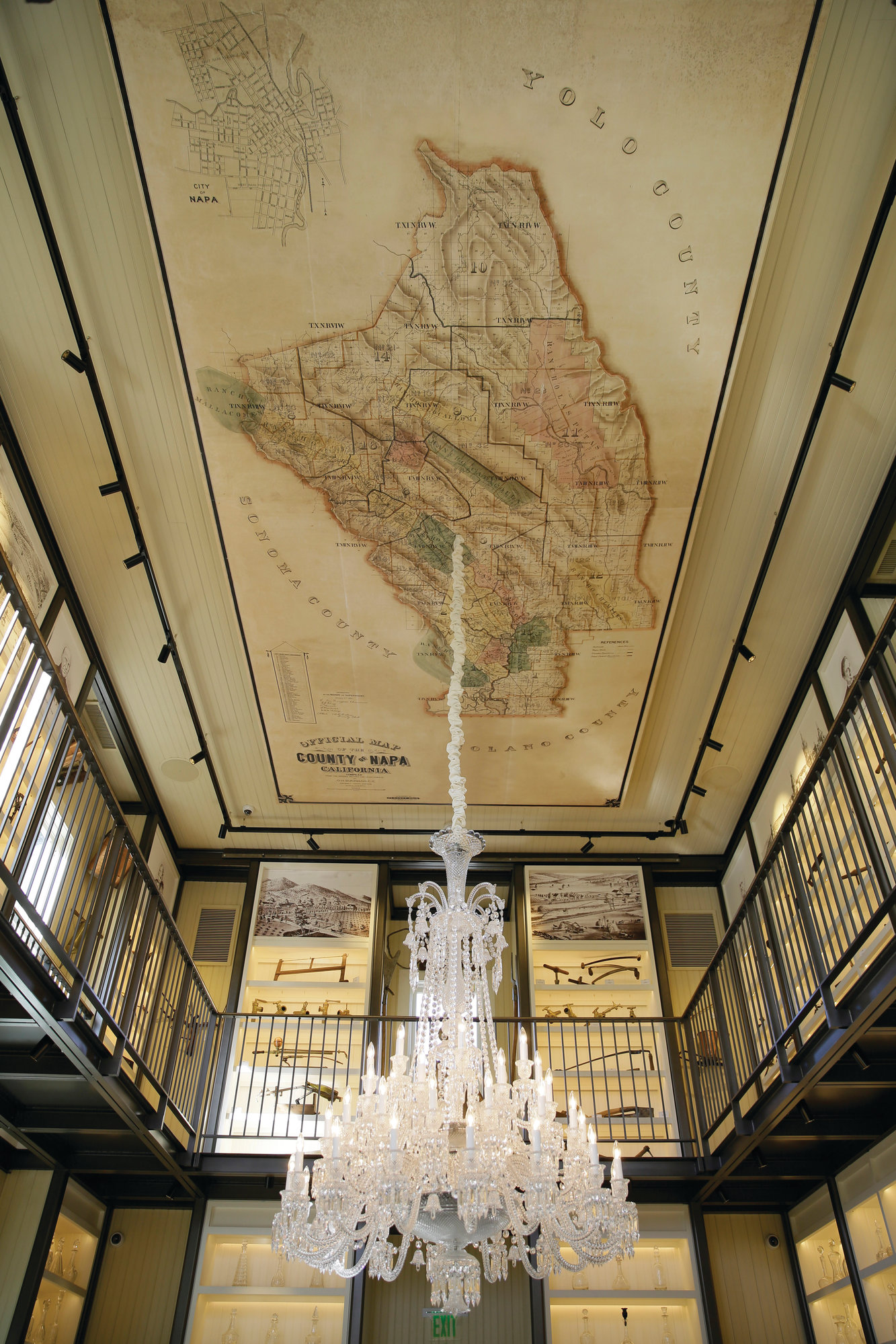 The Associated Press In this photo taken Wednesday, June 5, 2019, a 48-light Baccarat crystal chandelier and a reproduction of an 1895 map of Napa County on canvas hang from the ceiling of the 1881 Napa in Oakville, Calif.