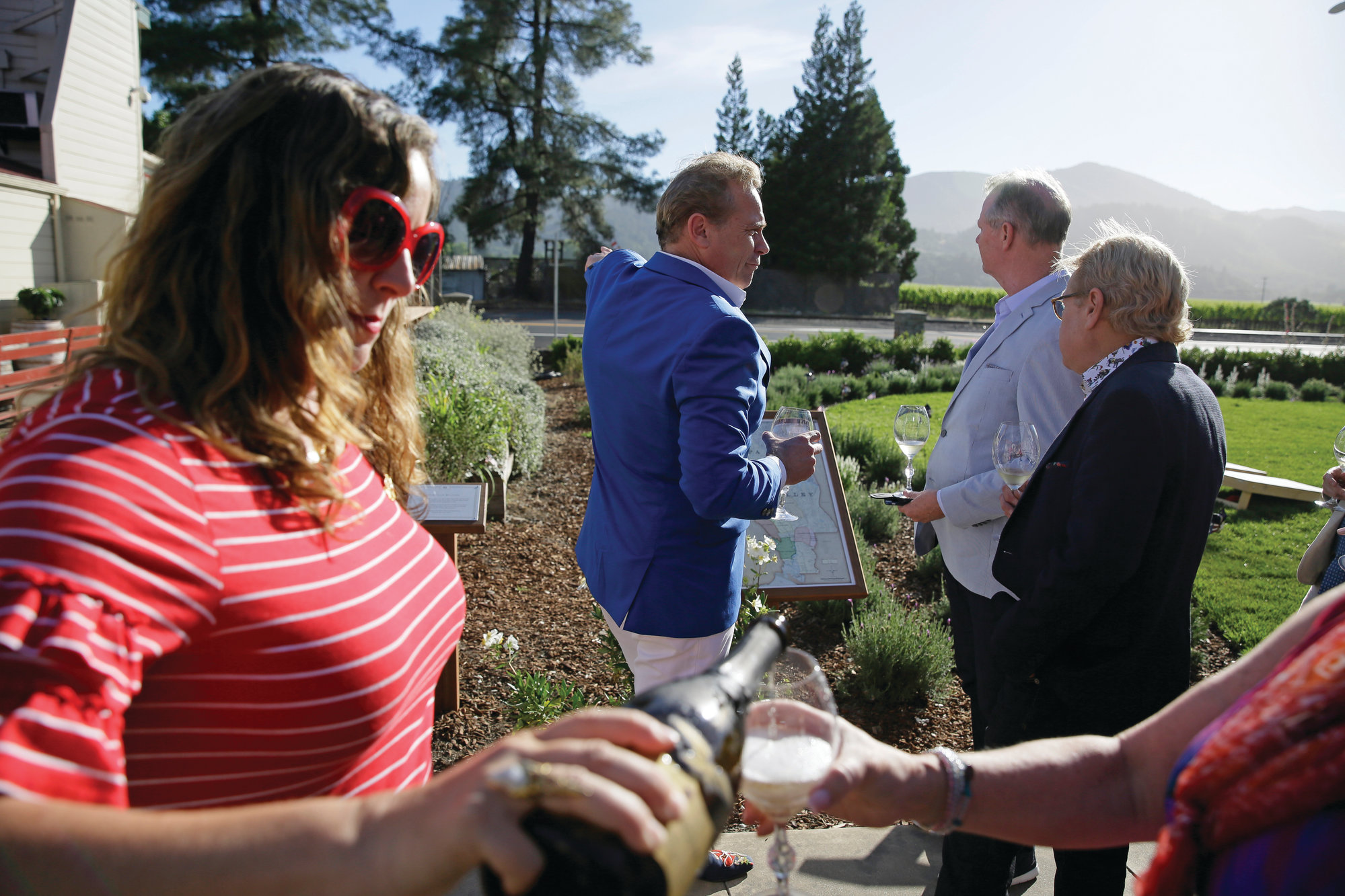 Photos by The Associated Press  Jean-Charles Boisset, center, leads guests on a tour of the grounds at 1881 Napa in Oakville, California, on June 5. The wine history museum and tasting salon opened this month.