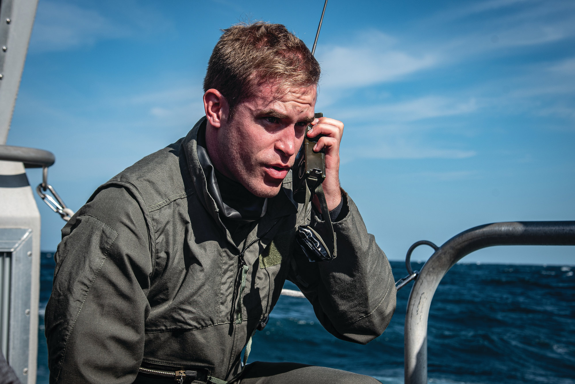 U.S. Air Force Capt. Kyle Rasmussen, 55th Fighter Squadron pilot, makes a mayday call during a search-and-recovery exercise. Pilots had to work with a rescue helicopter to indicate where they were located in the water.