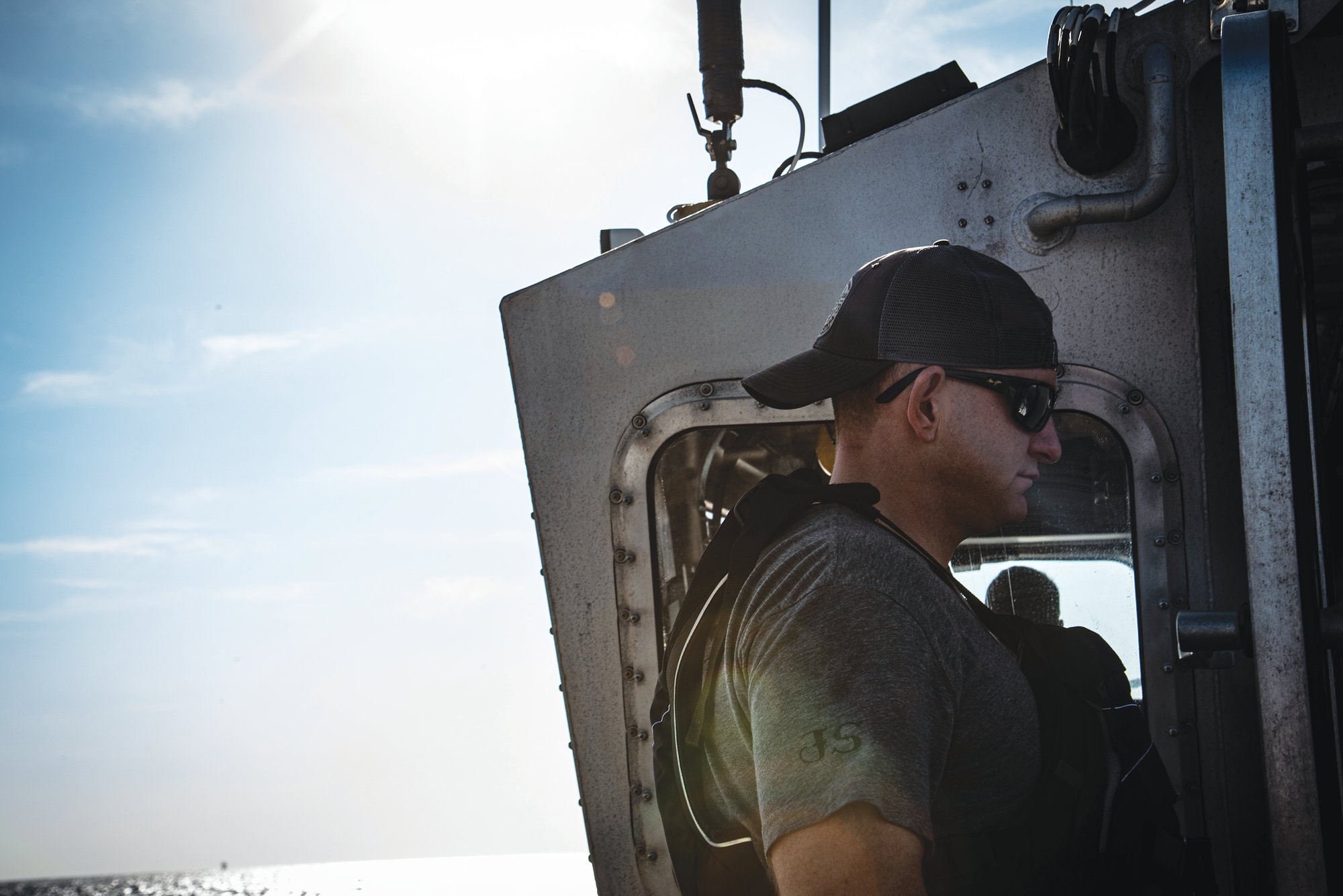 U.S. Air Force Tech. Sgt. David Jones, 20th Operations Support Squadron survival, evasion, resistance and escape noncommissioned officer in charge, prepares to participate in a joint training exercise with the U.S. Coast Guard off the coast of Tybee Island Coast Guard Station, Georgia, June 21. Jones helped prepare the pilots for what they might experience if they ever found themselves in this situation in the real world.