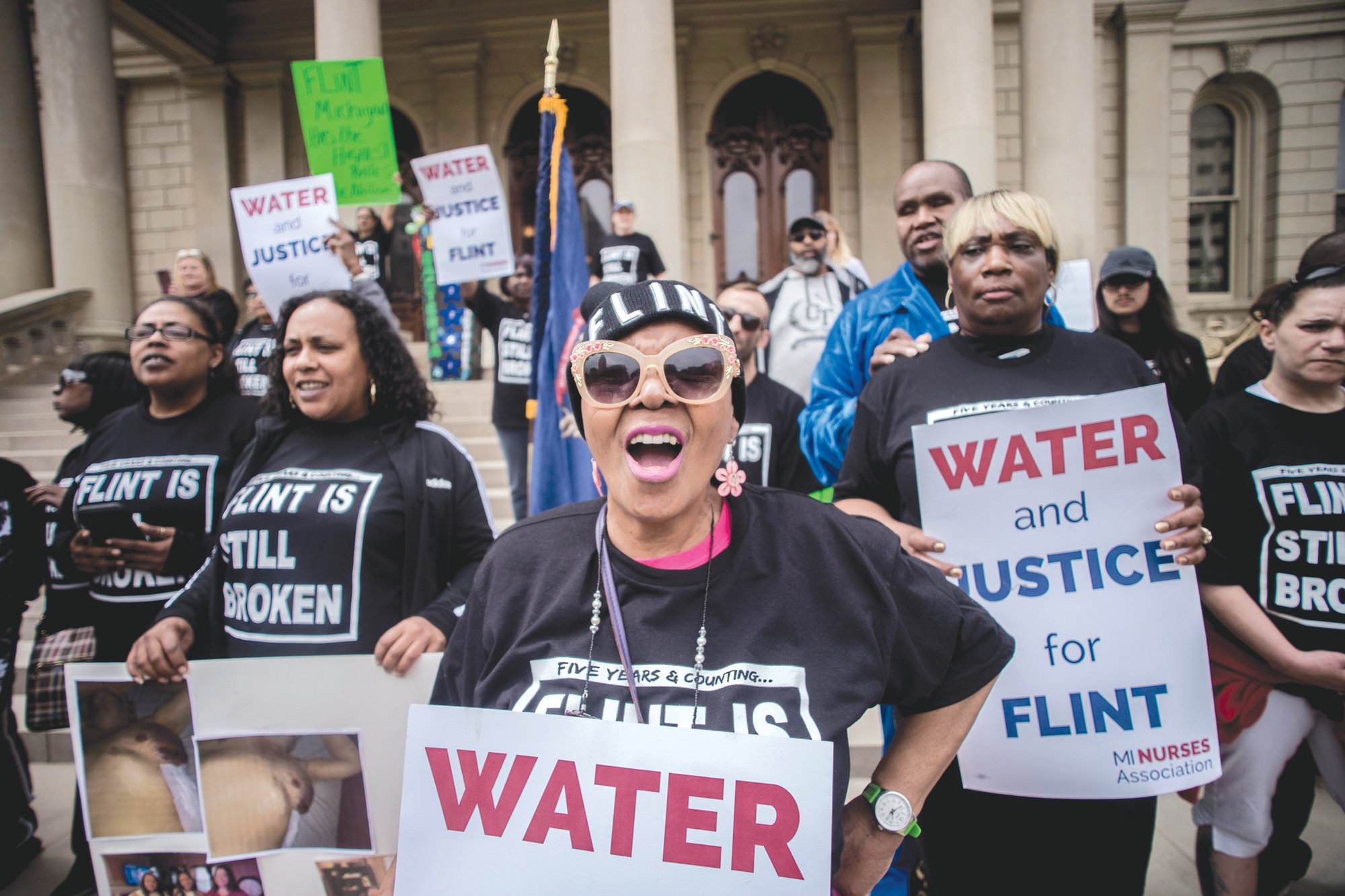 "Flint resident Freddie Fisher shouts out ""No justice, no peace!"" as she joins more than 50 Flint residents who rallied on the five-year anniversary of the Flint water crisis on April 25 in Lansing, Michigan."