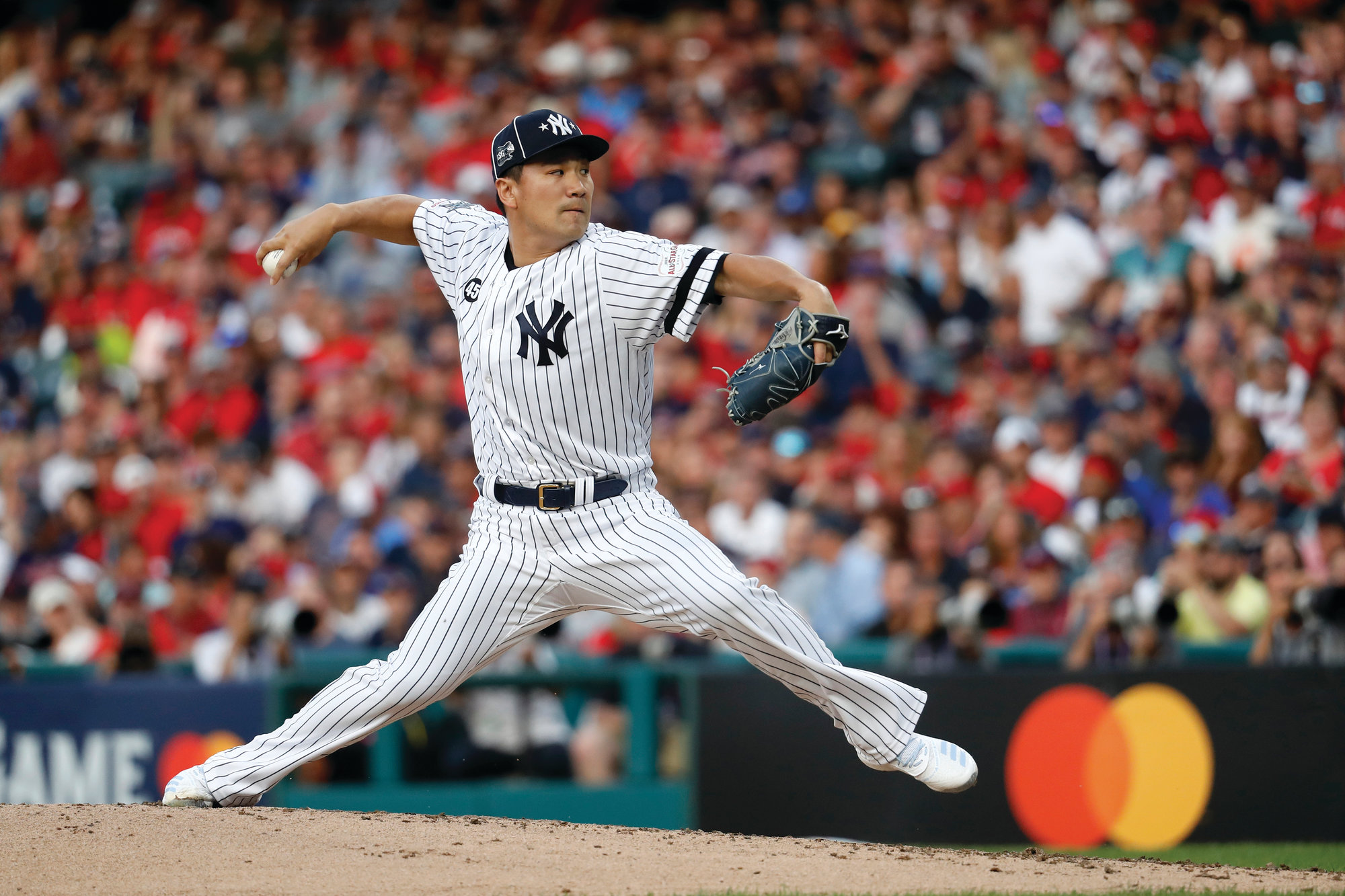 THE ASSOCIATED PRESSAmerican League Masahiro Tanaka of the New York Yankees throws during the second inning of the MLB baseball All-Star Game against the National League on Tuesday in Cleveland.