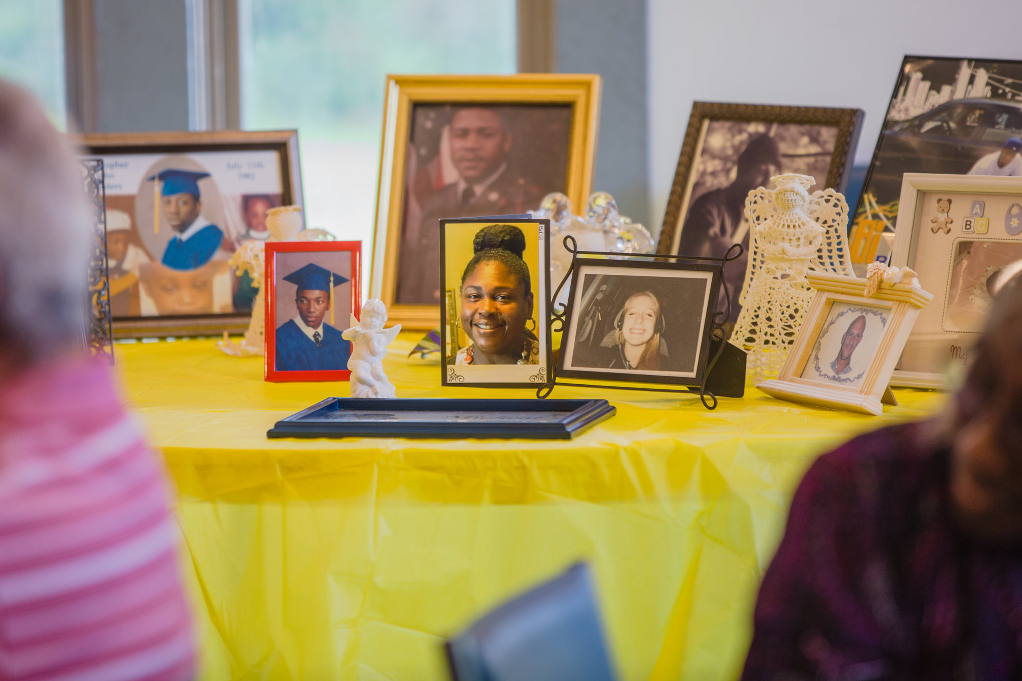 Photos of children that members of the Mothers of Angels have lost are displayed during the group's annual luncheon.