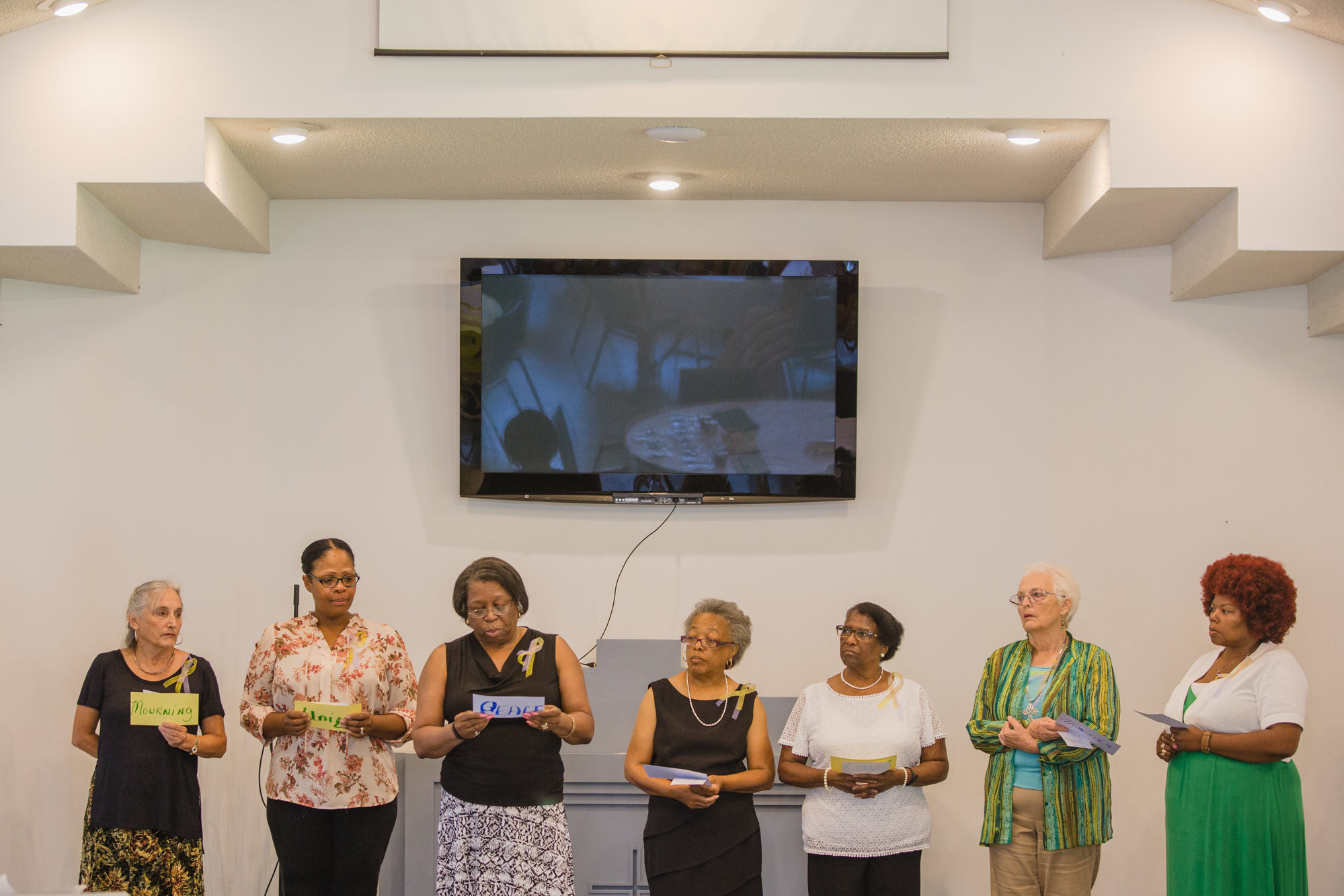 Mothers of Angels members sing a song during their annual luncheon at Wise Drive Baptist Church.