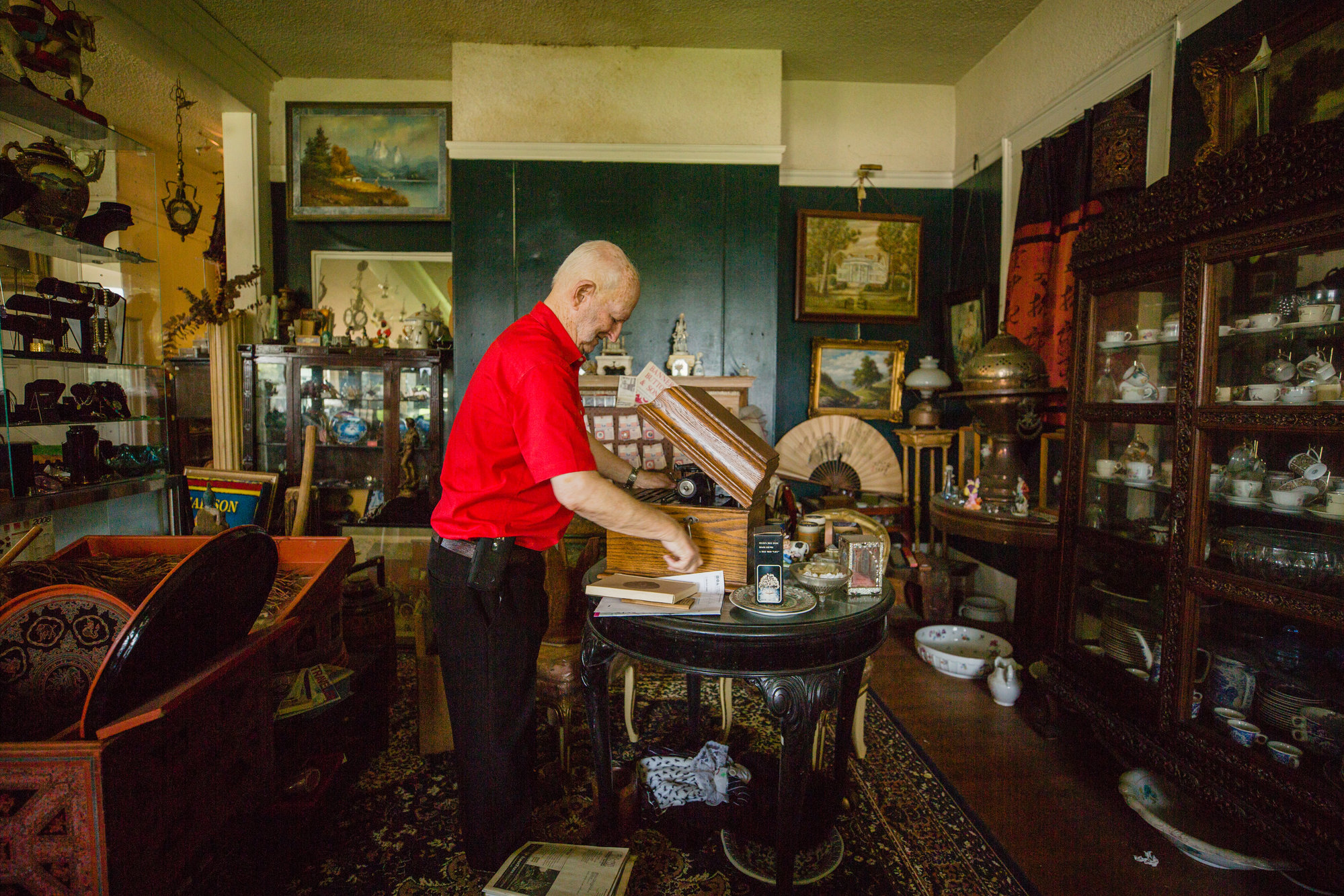 Don Cann plays an original Edison phonograph in his museum on Broad Street in Sumter.