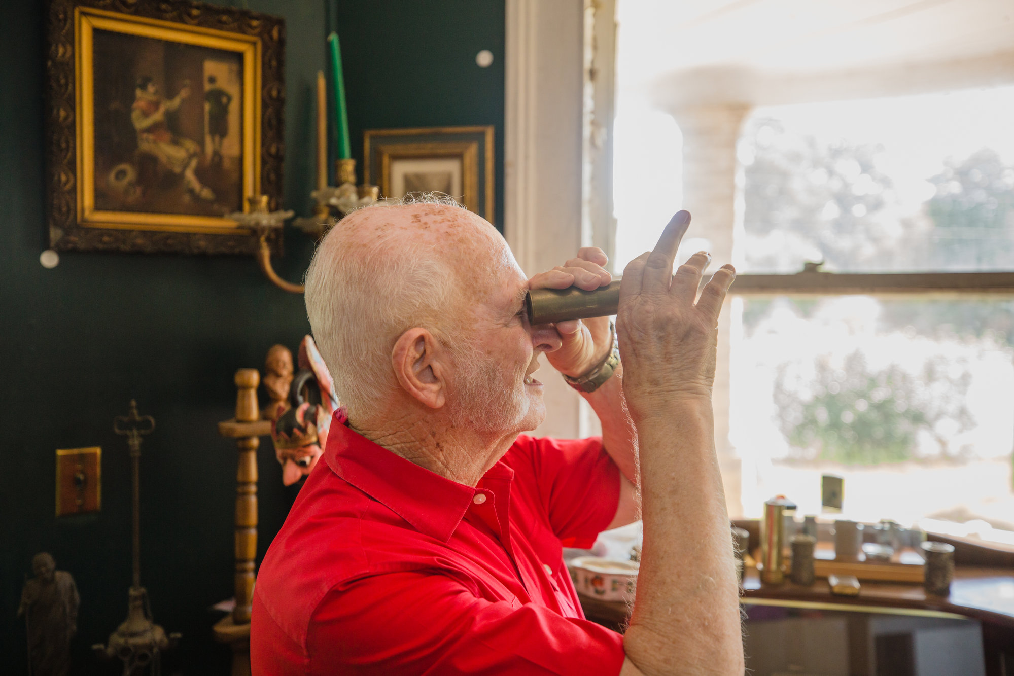 Don Cann looks through a kaleidoscope in his museum.