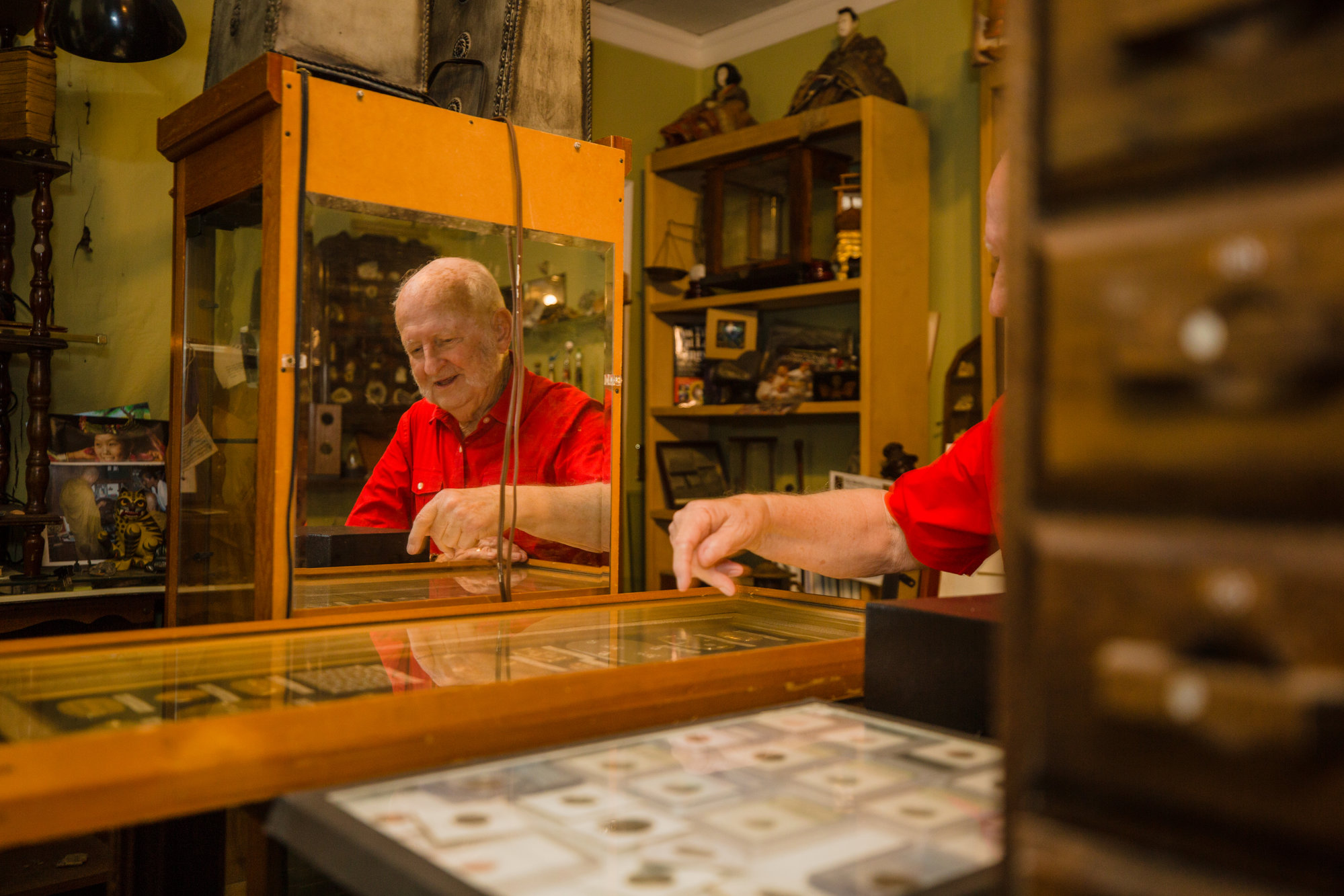 Don Cann looks at coins in his museum, Global Curiosities by The Southern Cross, on Friday. He recently bought a 1962 Studebaker Gran Turismo Hawk to add to his collection; he thinks it's the only such car in Sumter.