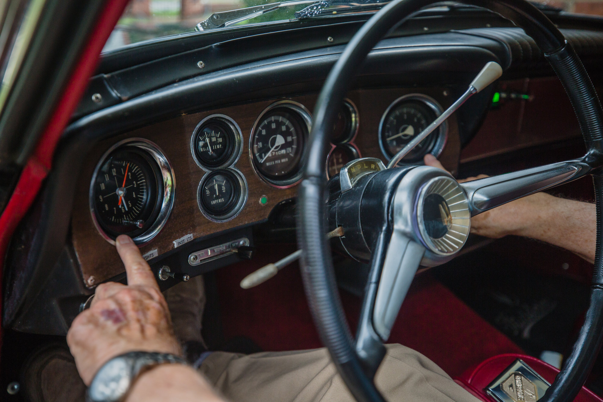 Don Cann shows the dashboard of his 1962 Studebaker Gran Turismo Hawk.