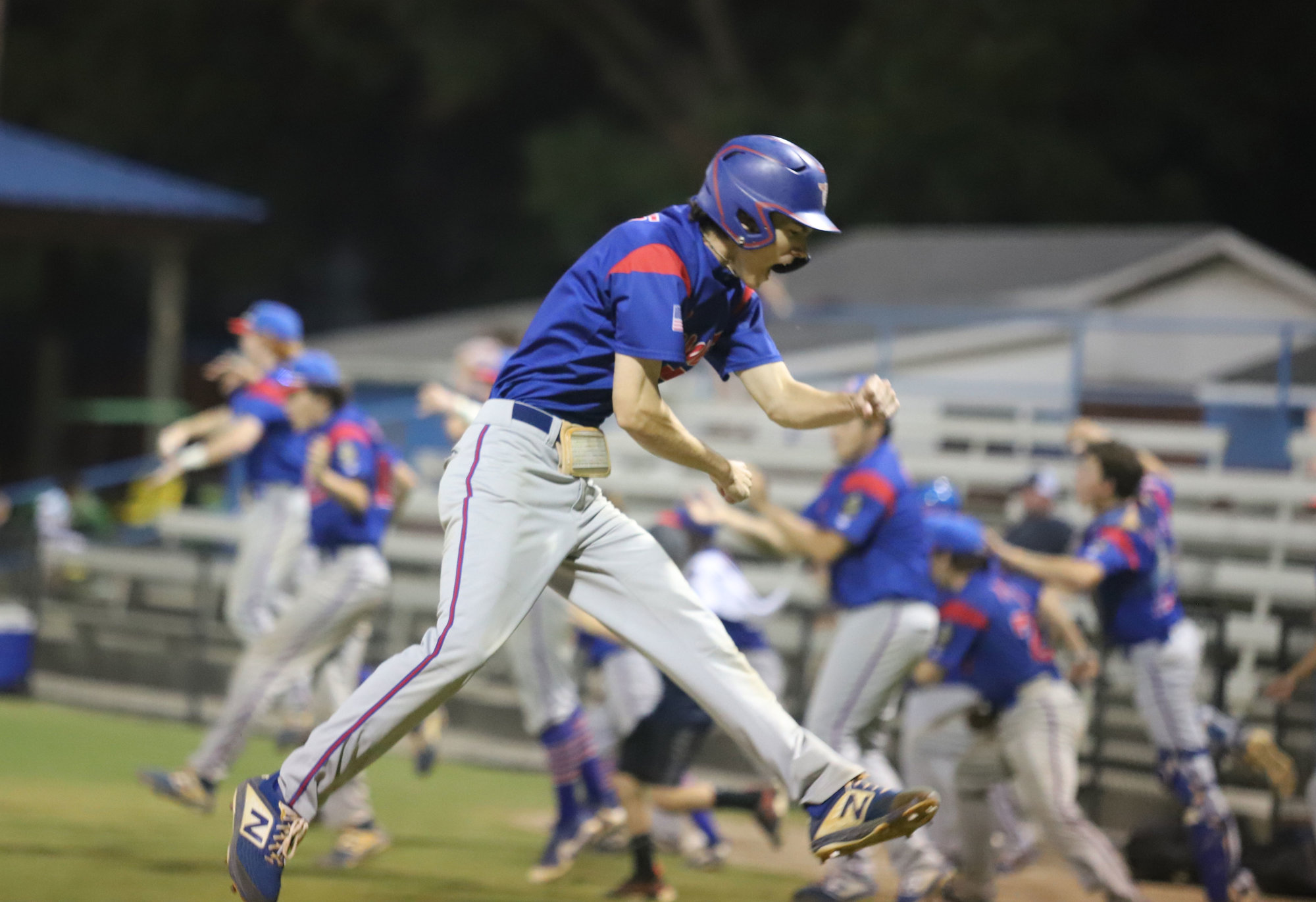 Jackson Hoshour crosses the plate with the winning run in Sumter's 4-3 victory over Goose Creek Post 166.