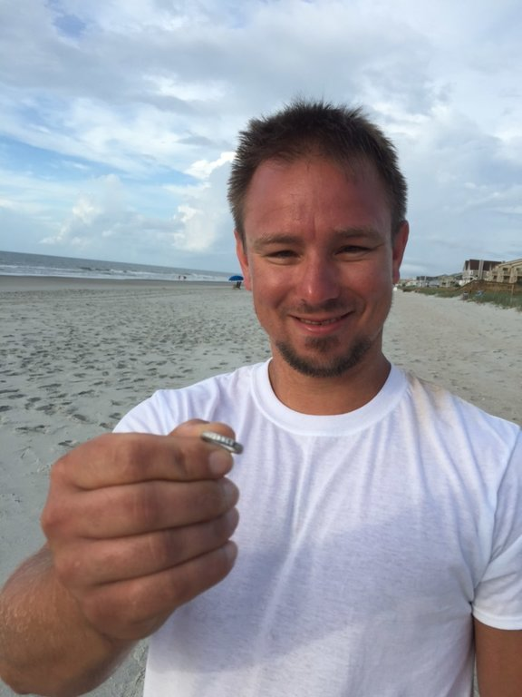 TJ Hansen holds the wedding ring he helped Jeanette White find with his metal detector. Hansen lives in Sumter.