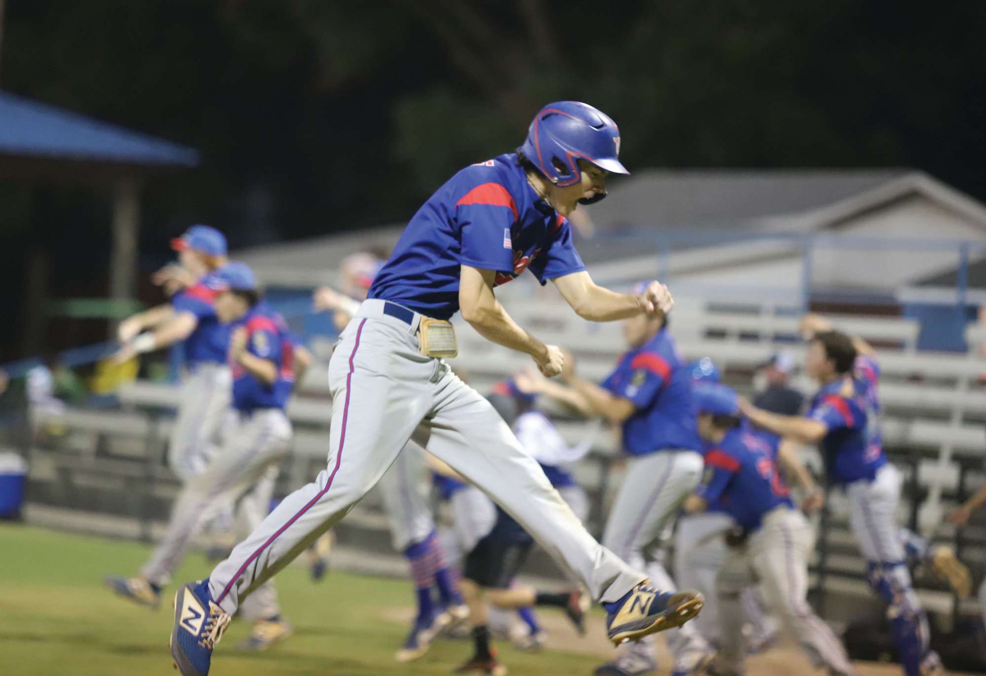J. SCOTT SEWELL / The Sumter Item  Sumter's Jackson Hoshour leaps into the air in celebration after scoring the winning run in the P-15's 4-3 victory over Goose Creek Post 166 on Wednesday at Riley Park. The win gave Sumter a 2-0 lead in the best-of-5 third-round American Legion state playoffs series.