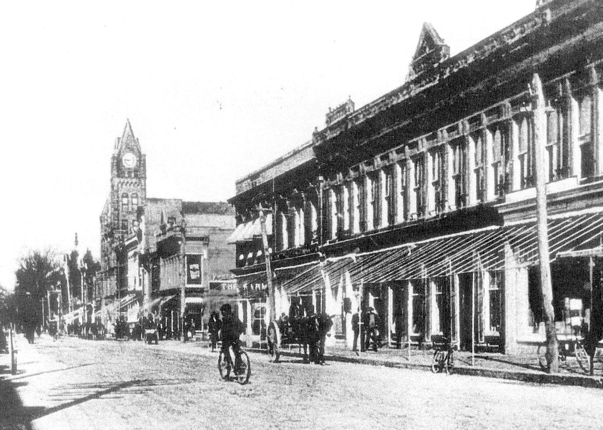 Main Street looking north from the Monaghan block is seen about 1900. Sumter Dry Goods is seen in the middle with the awnings on its windows.