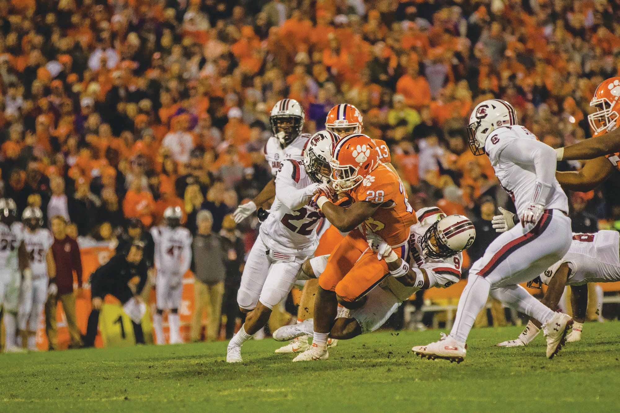 SUMTER ITEM FILE PHOTOFormer Clemson running back Tavien Feaster (20) is shown running the football against South Carolina in the Tigers' 56-35 victory last season. Feaster has announced he will be playing for USC this season as a graduate transfer.
