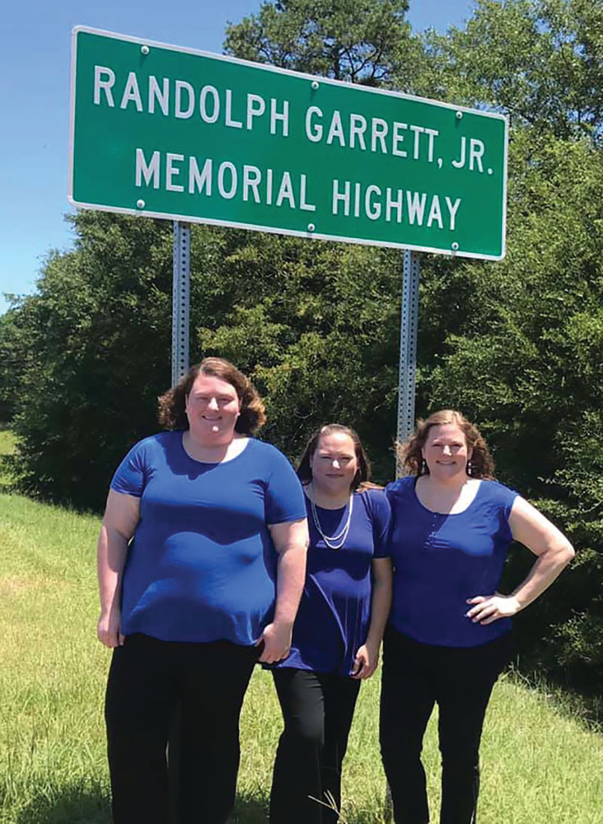 The daughters of the late Randy Garrett, former sheriff of Clarendon County, are seen at the sign naming the portion of Interstate 95 from exit 102 to exit 115 the Randolph Garrett Jr. Memorial Highway.