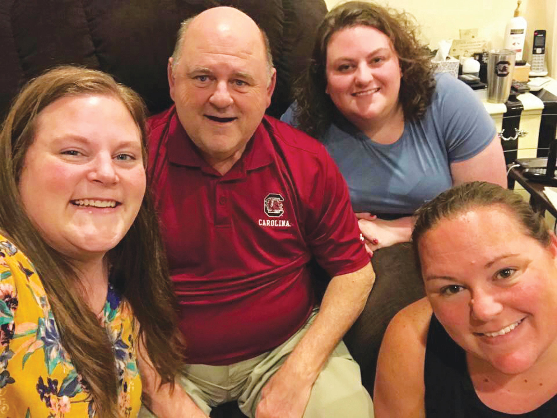 Former Clarendon County Sheriff Randy Garrett is surrounded by his daughters, Christina Garrett, Brittney Garrett and Lamonda Sweat. Garrett died in August 2018 after a brief illness.