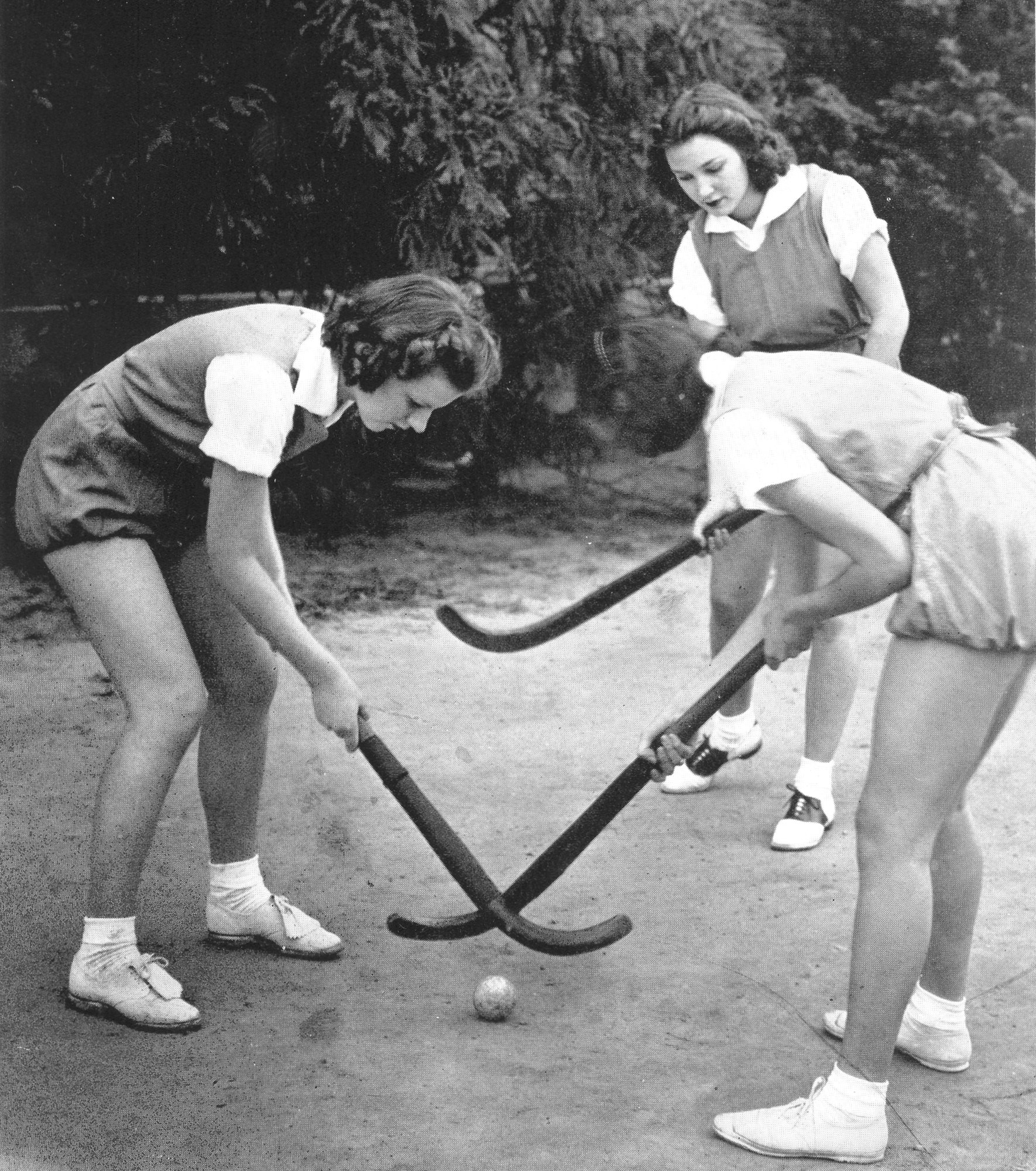 A group of Sumter High School girls plays field hockey in 1938. Field hockey was a popular sport until the 1950s.
